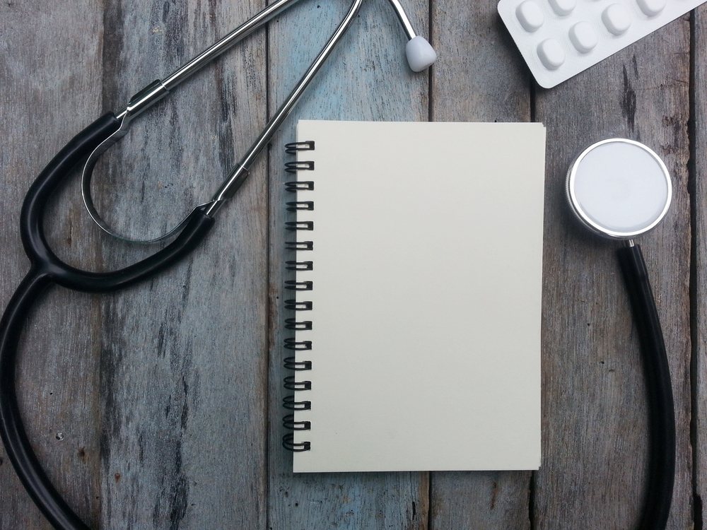 Stethoscope and a notebook