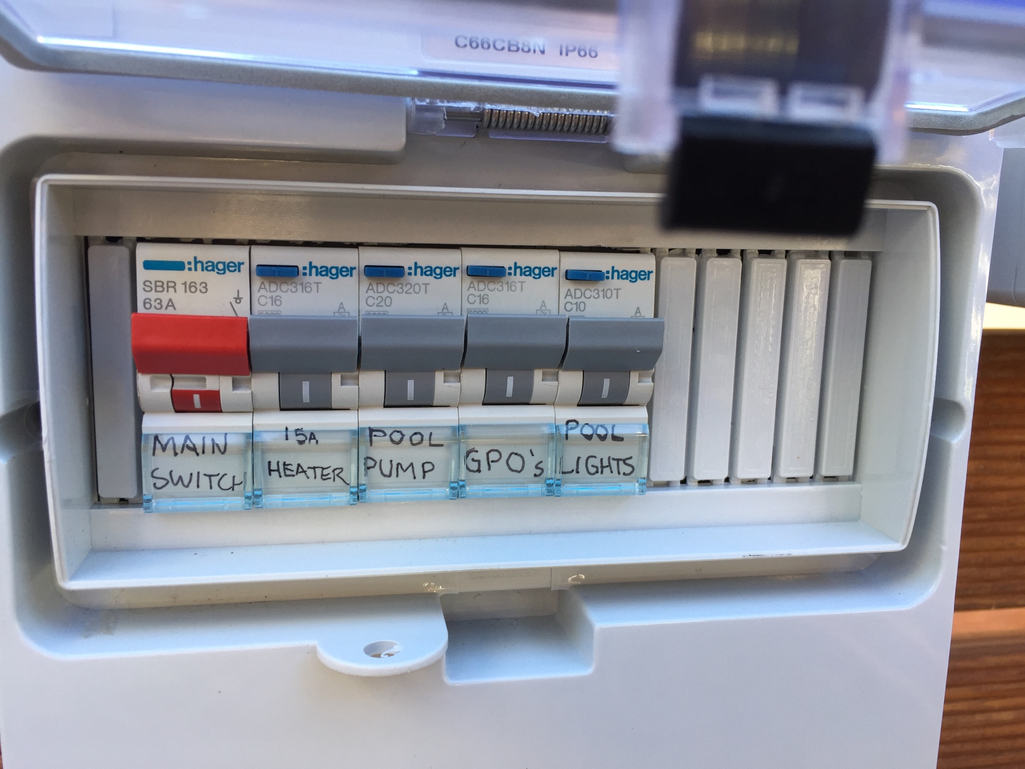Pictured is the main switch which provides the power. The other four are safety switches. The blue switch at the top of each safety switch is a test button. It is best practise to test these every three months to ensure they are working as they should.