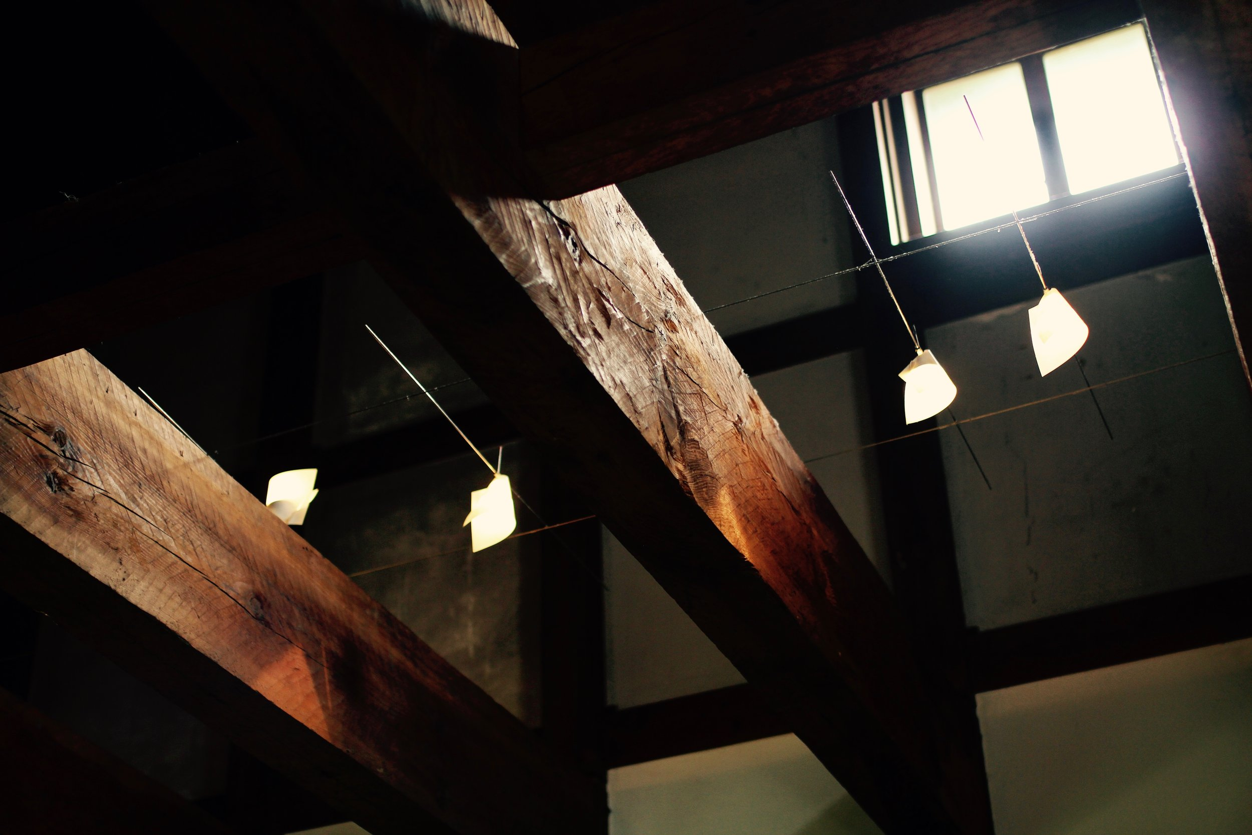 Detail of modern wood beams brought in to restore the interior of the warehouse.