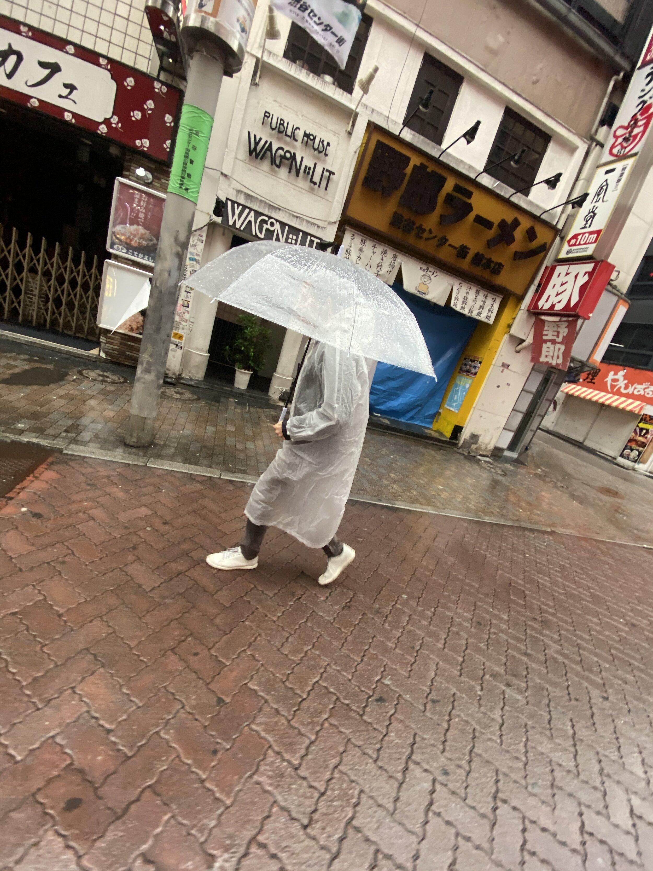 Man Walking Through Tokyo Typhoon