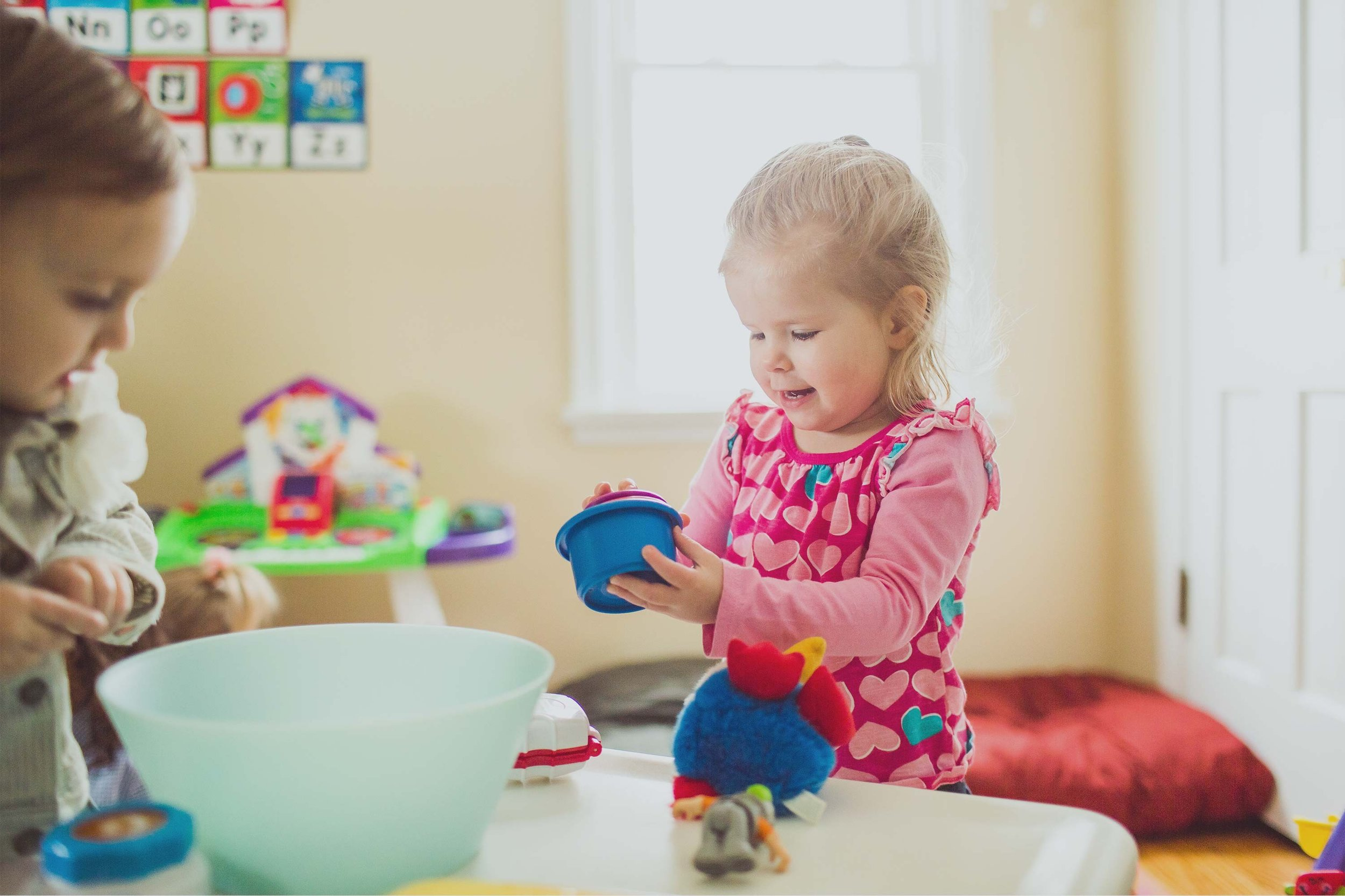 AN IN-HOME CHILD CARE COMPANY   Your child's home-away-from-home in your neighborhood and our backyards   HOW IT WORKS