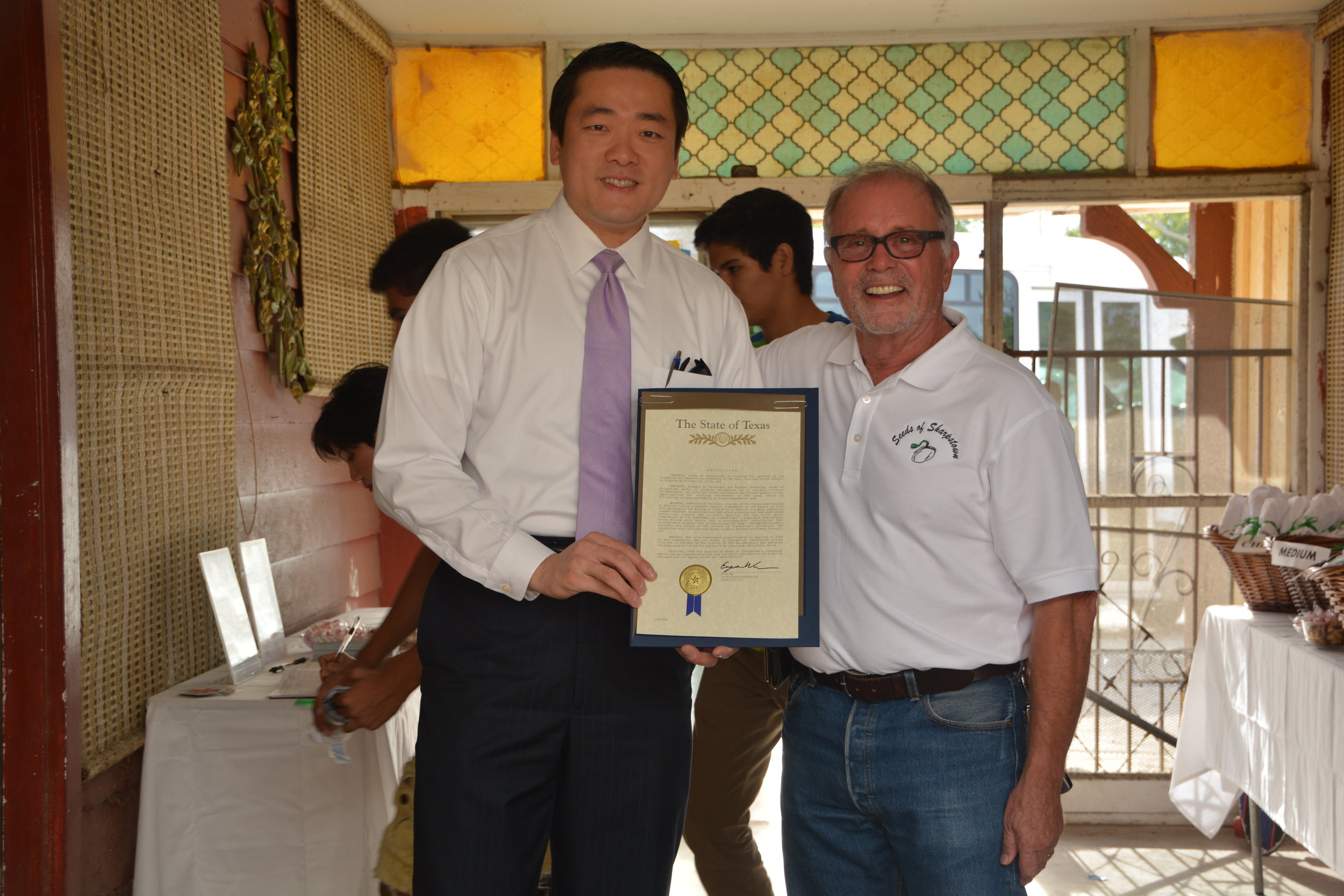 Gene Wu presents Seeds of Sharpstpown's Michael Prentice with a proclamation from the State of Texas House during the Remnants of the Past, Visions of the Future reception.