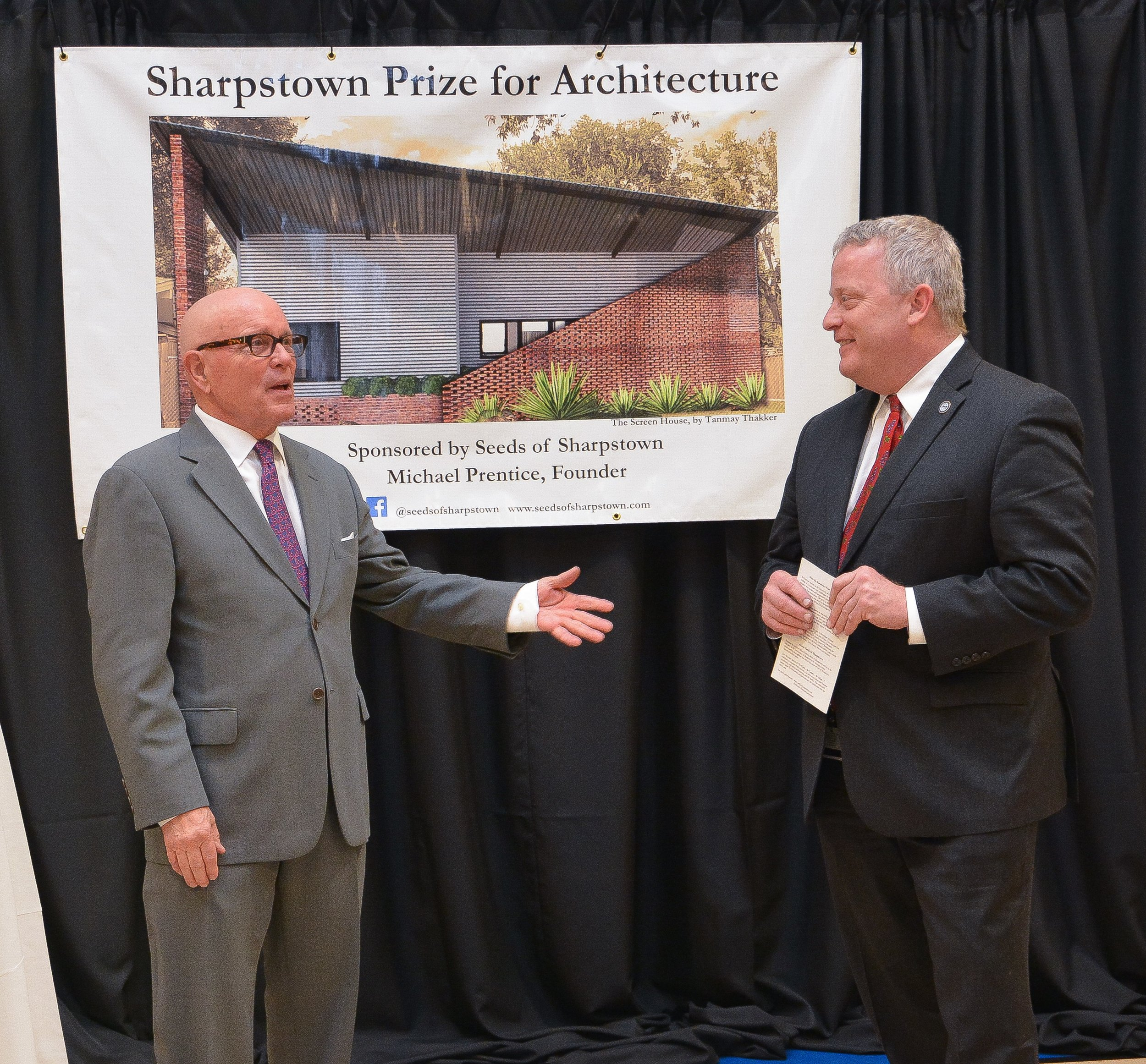 Michael Prentice is joined by Houston City Councilman David Robinson during remarks at the Sharpstown Prize for Architecture exhibition.