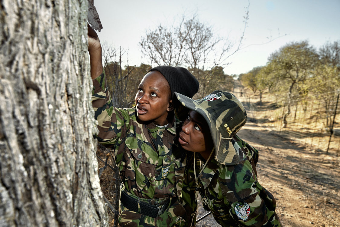 Black Mambas Felicia (left) & Joy checking and reloading camera traps