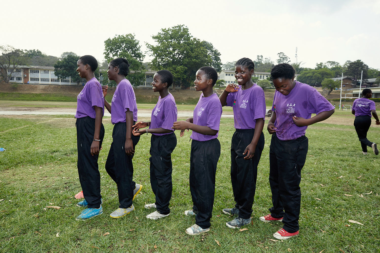 Girls line up for their turn during training
