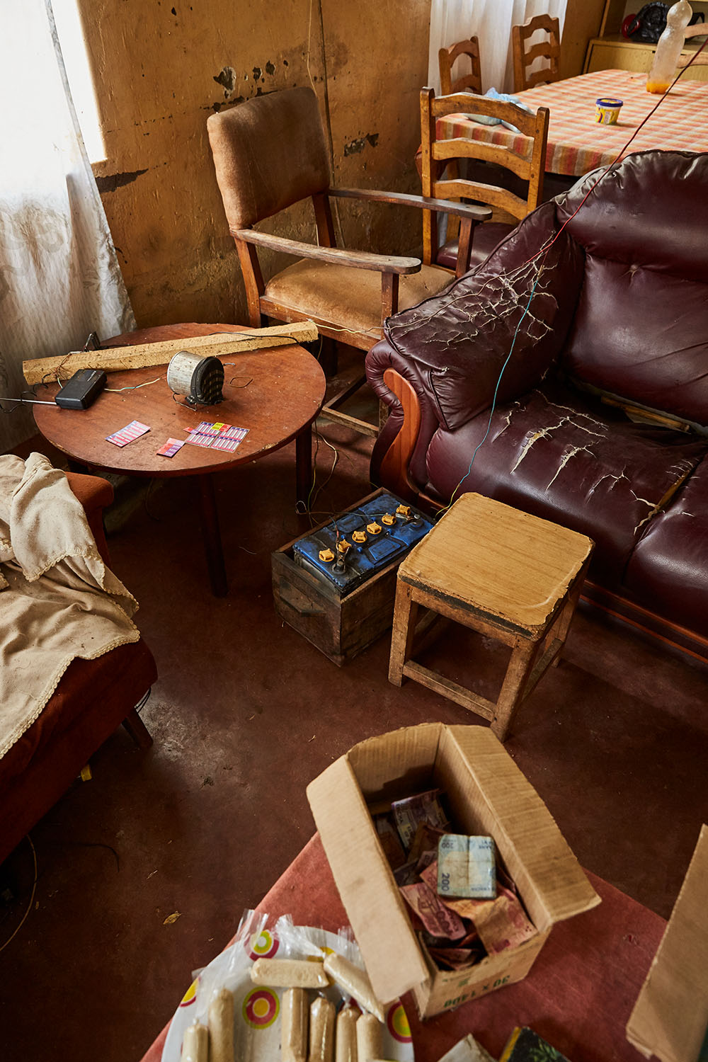 "The living room of Felix Wonga's home, Luchenza, southern Malawi, 2017.  The solar panels that Felix uses for his mobile phone charging business also powers their lights, and several small radio's and speakers. Felix: ""We are the only ones in this area that have a charging business. If more people in this area had solar panels it would very much improve their lives. ESCOM [the national provider], is too expensive and not reliable."""