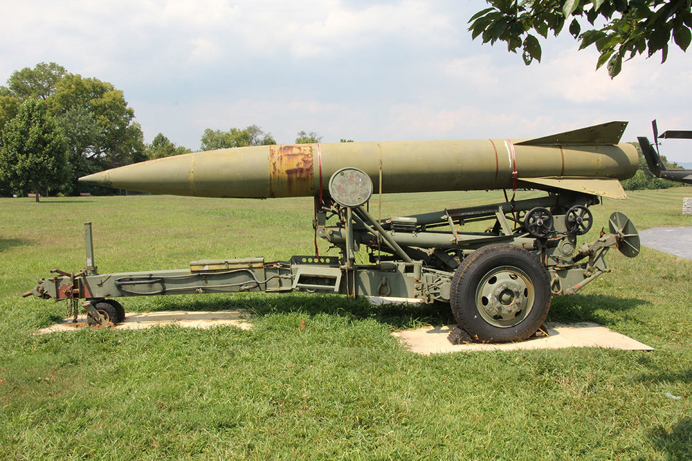 Before: military missile with weather damage