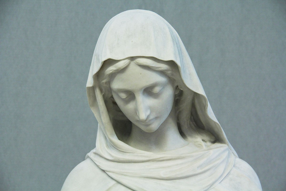 After sculpture restoration services and the removal of layers of flaking paint.