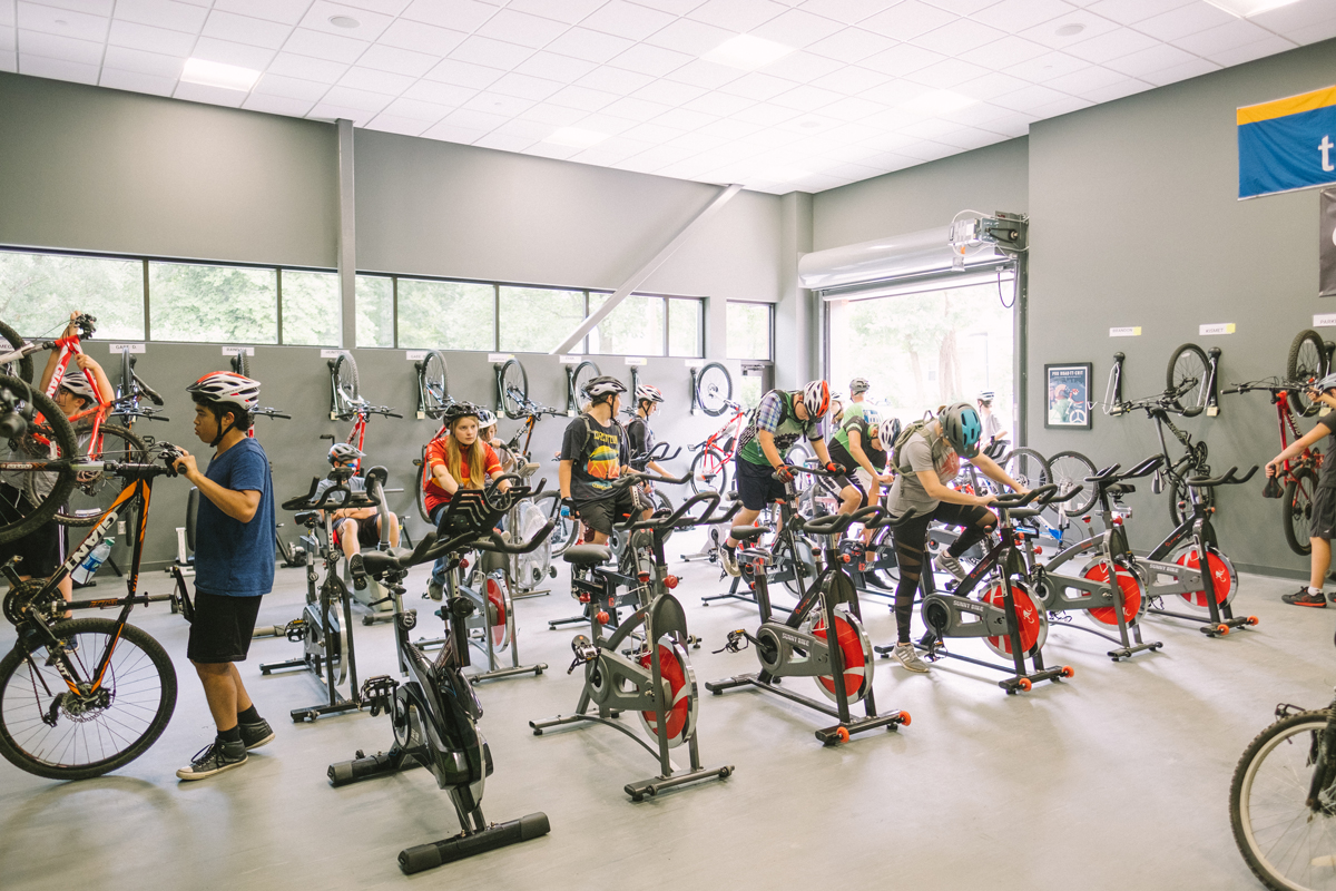 FROM TOP: Students at the Arkansas Arts Academy log some time on indoor trainers.