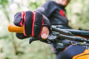 """The Gloves  """"I don't wear gloves when riding the road but I always do on gravel or the trails. I like full-fingered gloves. I cut the tip off the index finger on the right glove so I can have more sensitivity when braking/steering and if I need to use the phone a sweaty glove is very hard to get off.""""  Price varies."""