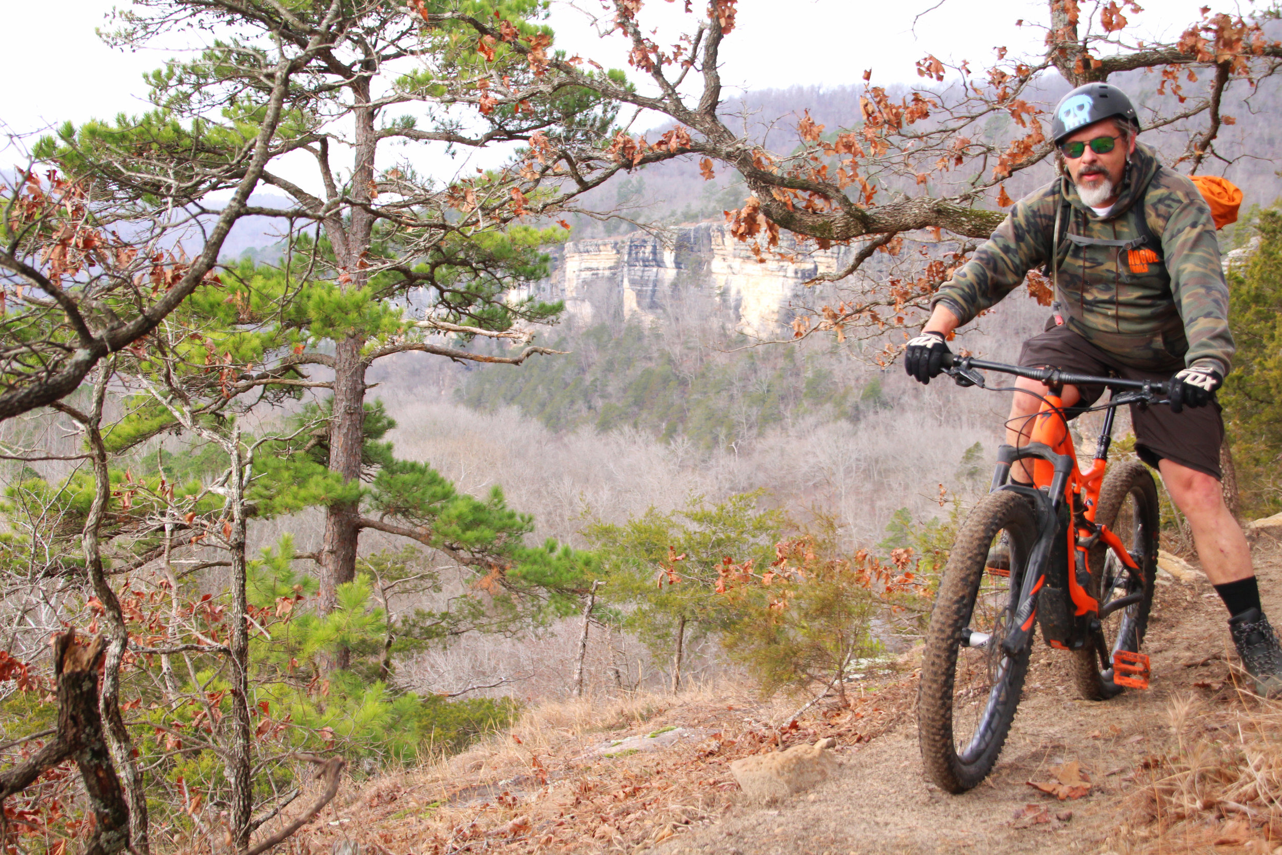 ENJOYING THE VIEW: Rogue Trails' founder/owner Phil Penny takes a break at an overlook on the Camp Orr Trail his company built in the Buffalo River valley.