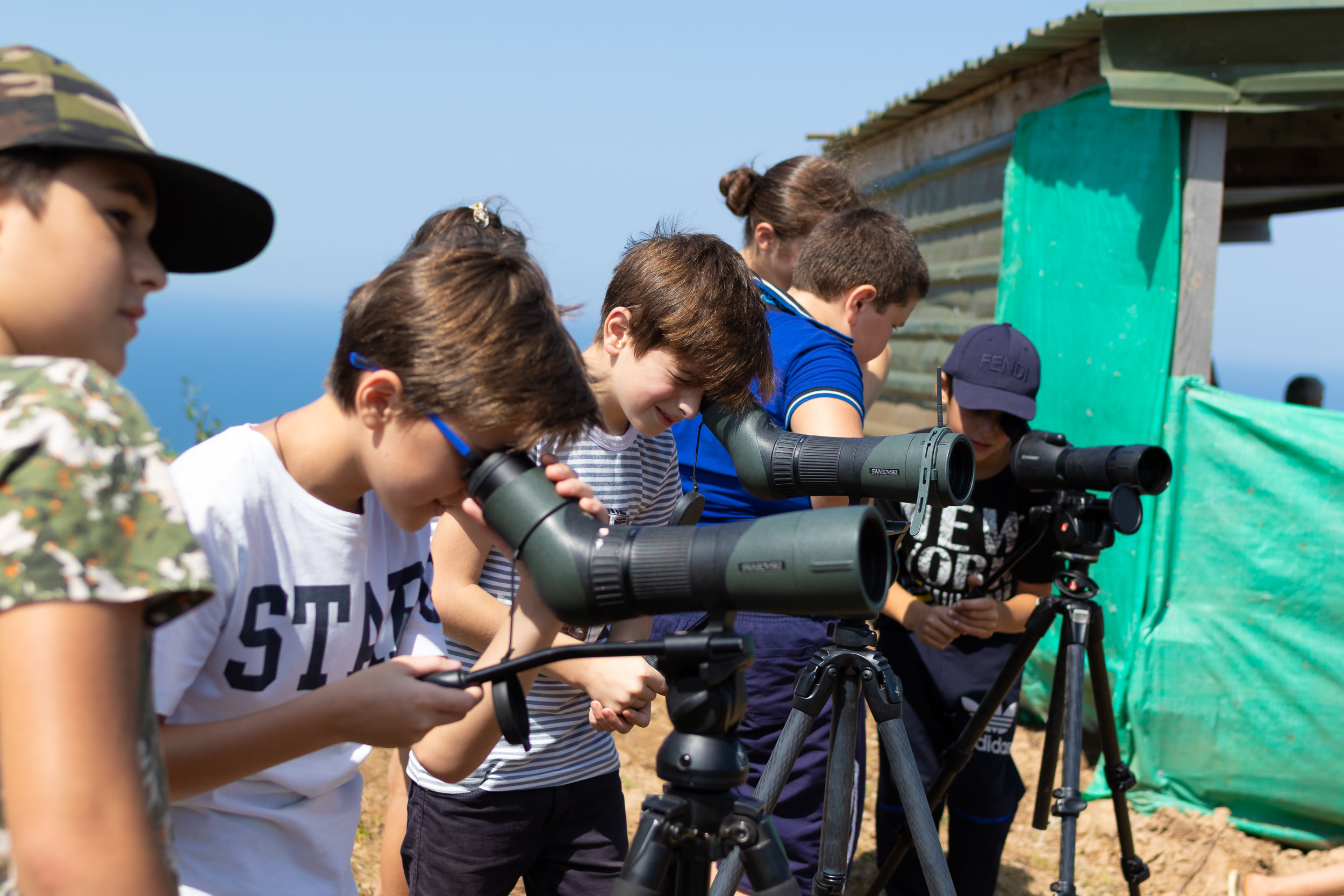 Children from local schools visit the stations and have their first peeks through binoculars and scopes. Photo by Bart Hoekstra.