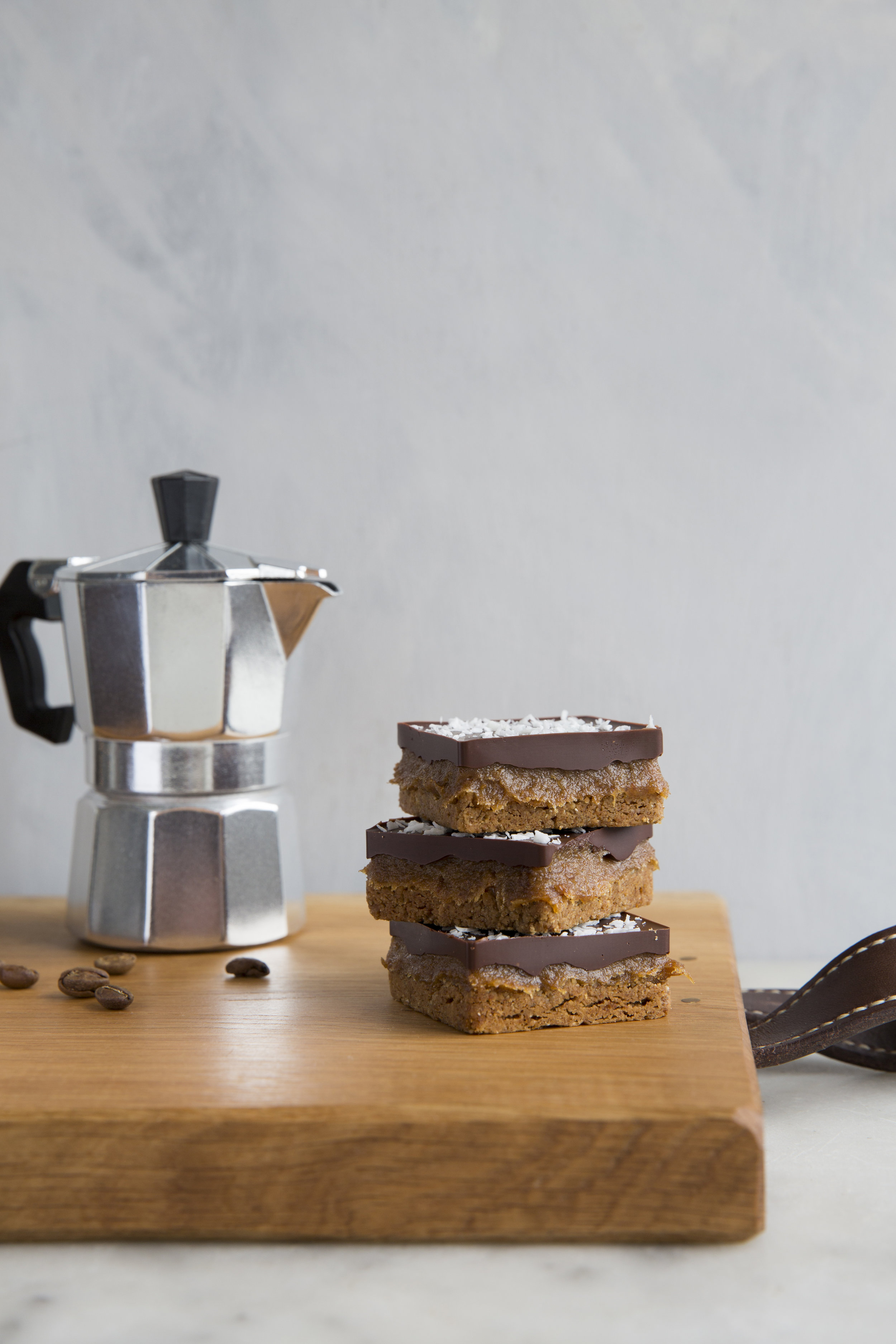 Three Elements. The coffee pot also has the added bonus of the black top lid handle which adds another peak to the landscape and the spout at this angle frames the stack of caramel short breads. The wave of leather to the right, leads the eye in or out of the image nicely.