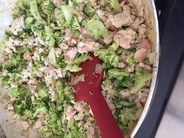 Cook the broccoli, onions, and meat till almost all pink is gone.
