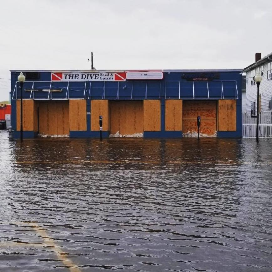 Plywood and sandbags and a lot of luck helped keep the original Shuckin' Shack Oyster Bar in Carolina Beach (far right) from washing away completely.