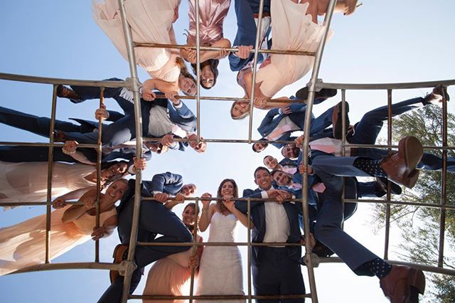 """We just had our 4th Anniversary!!! 🥂 I enjoyed looking through our wedding photos, and picked a few to share on here. This is one of my all time favorites. 👆🏼 There was a playground in the park where we got married, and our playful side just had to get this photo! It was a blast and turned out so good! 📷 . In the words of George Bernard Shaw, """"We don't stop playing because we grow old; we grow old because we stop playing."""" ✨ . Play can relieve stress, improve brain function, stimulate creativity, and improve social connections. I think I'll turn on some music and do some kitchen dancing with my little one today. How are YOU playing today?! 💃🏻☀️☔️🤸🏻♀️"""