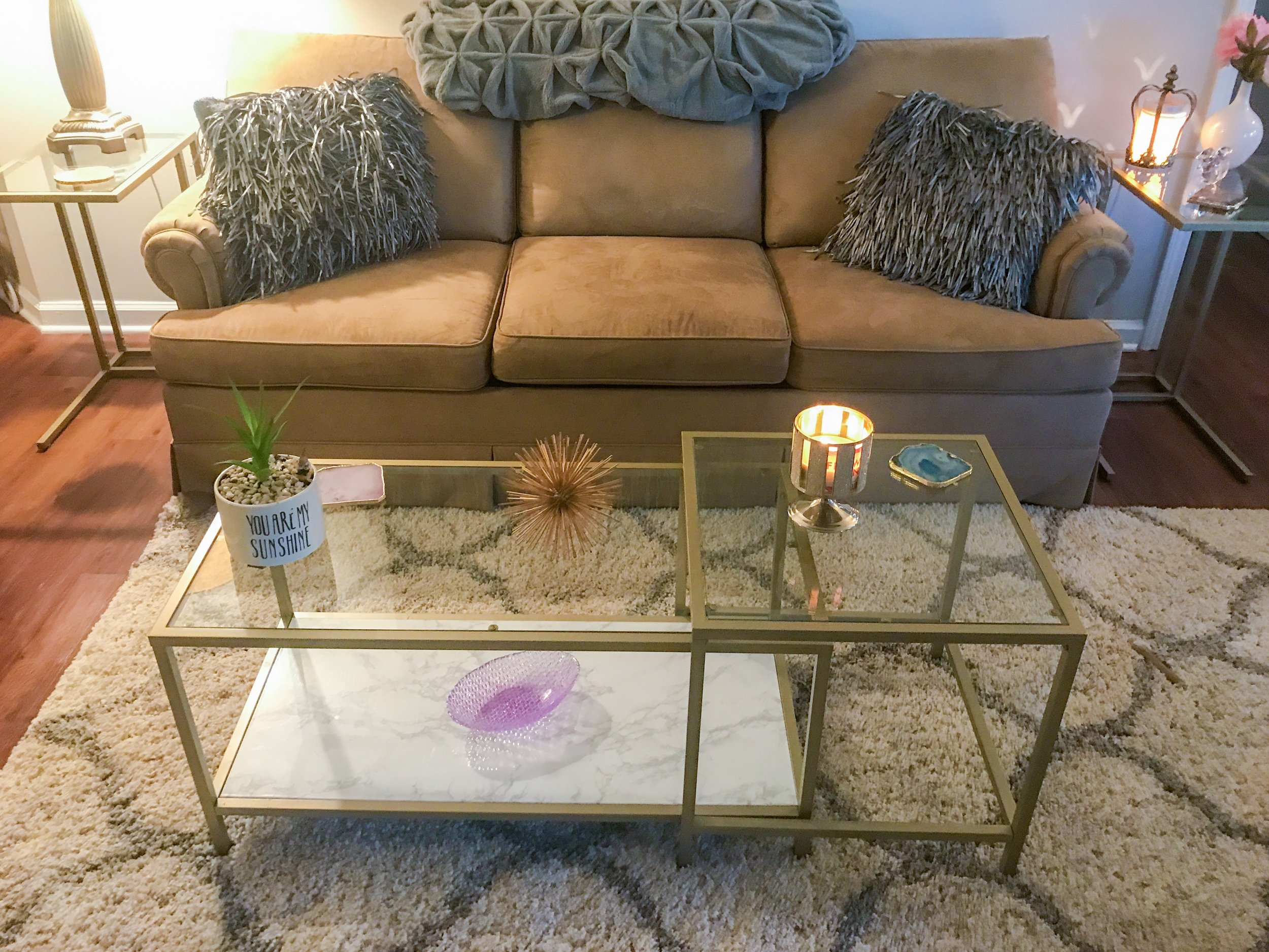 My favorite thing about my apartment is my  living room furniture  set. You may notice it looks like my wet bar and thats because I DIYed all of my living room furniture the same way! I spray painted the border edges and added  marble contact paper  to the bottom. Everyone is so surprised when I tell them it's not real marble!