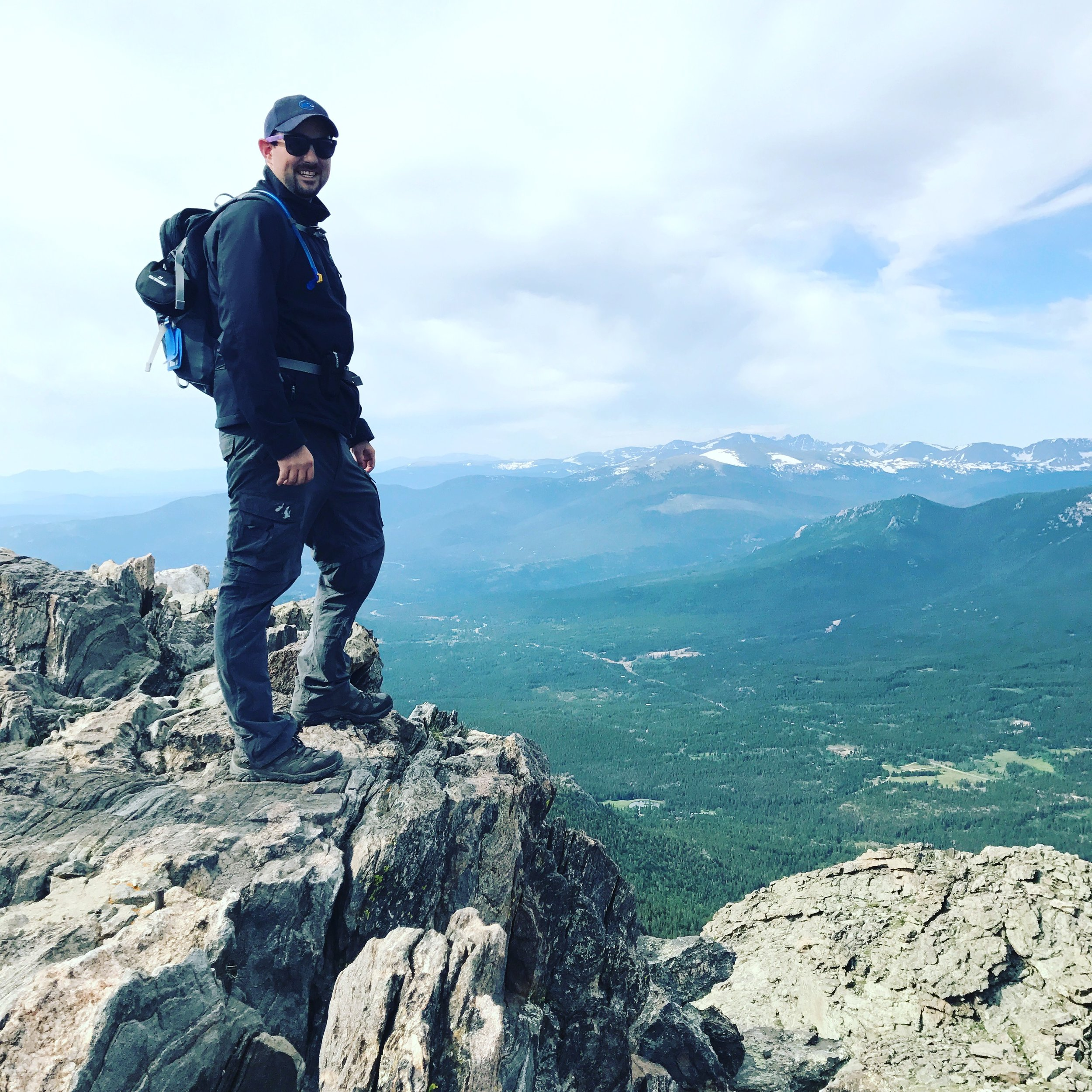 Ryan at the summit of the Twin Sisters in Colorado