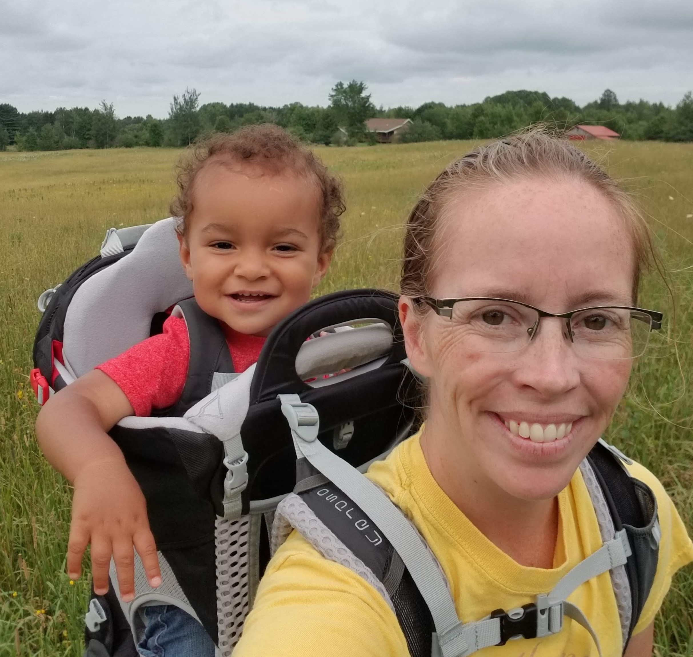 lauren and leo out for a hike on our land