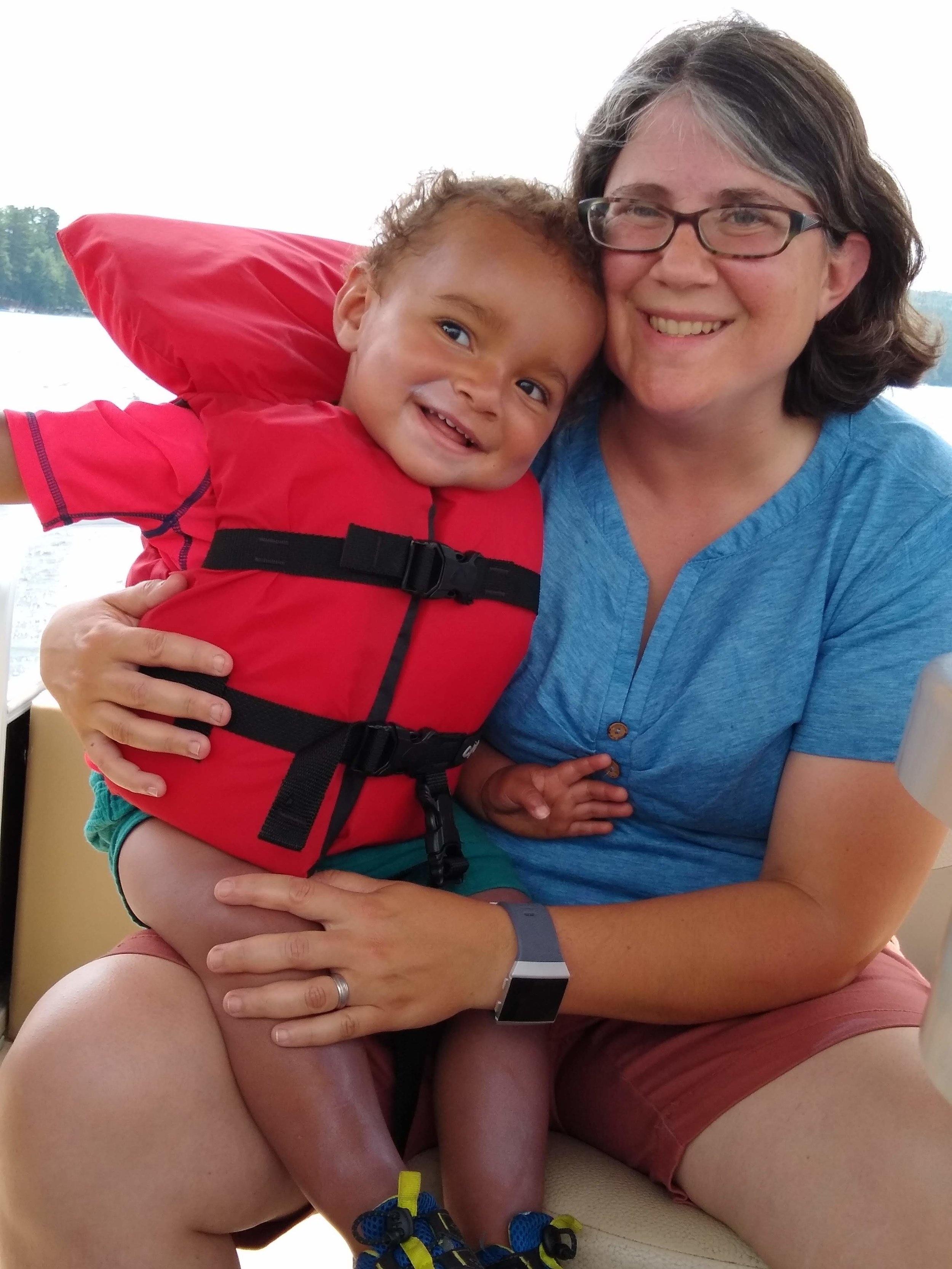 sara and leo enjoying a boat ride at the family lake house