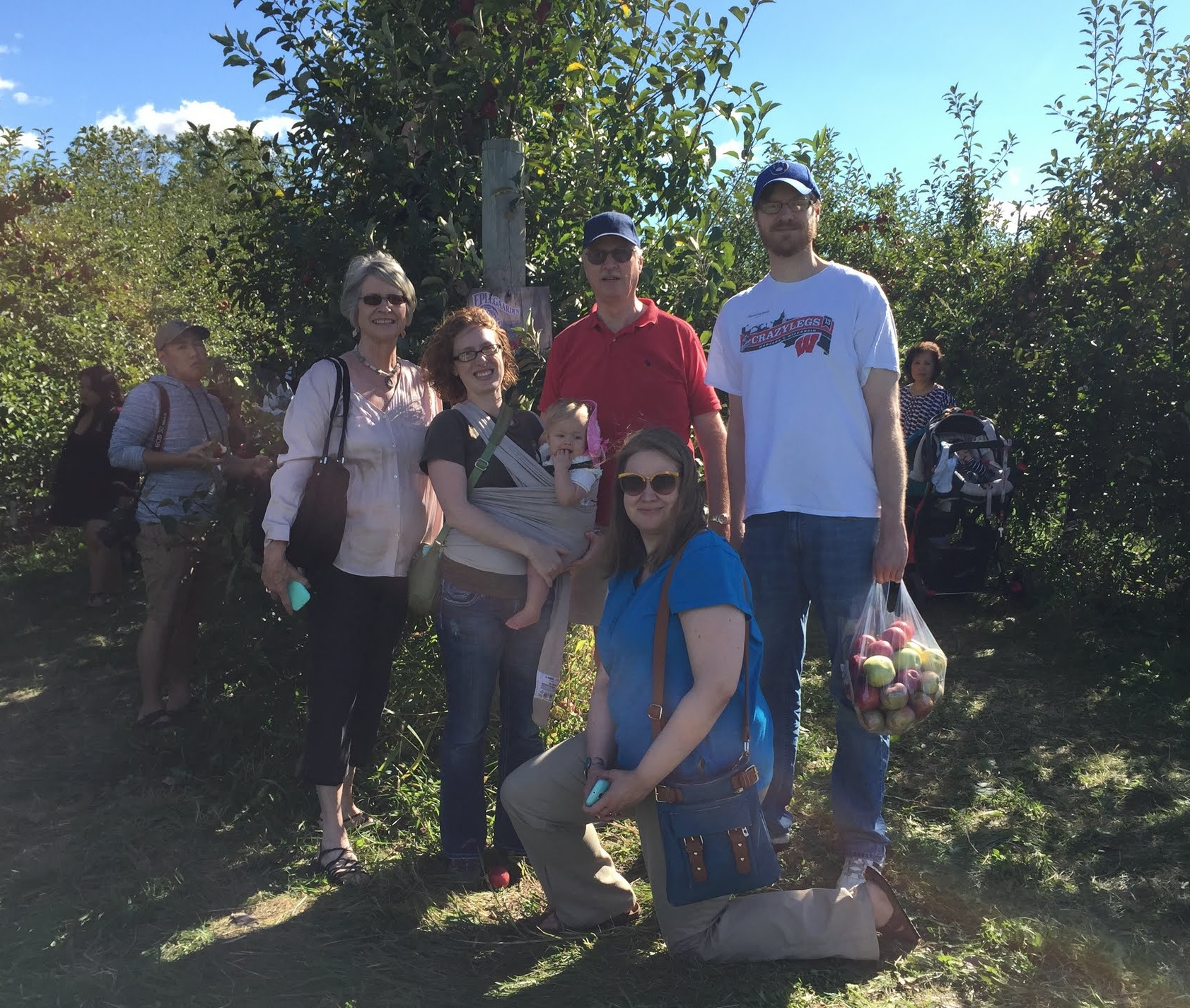 john's family at the apple orchard