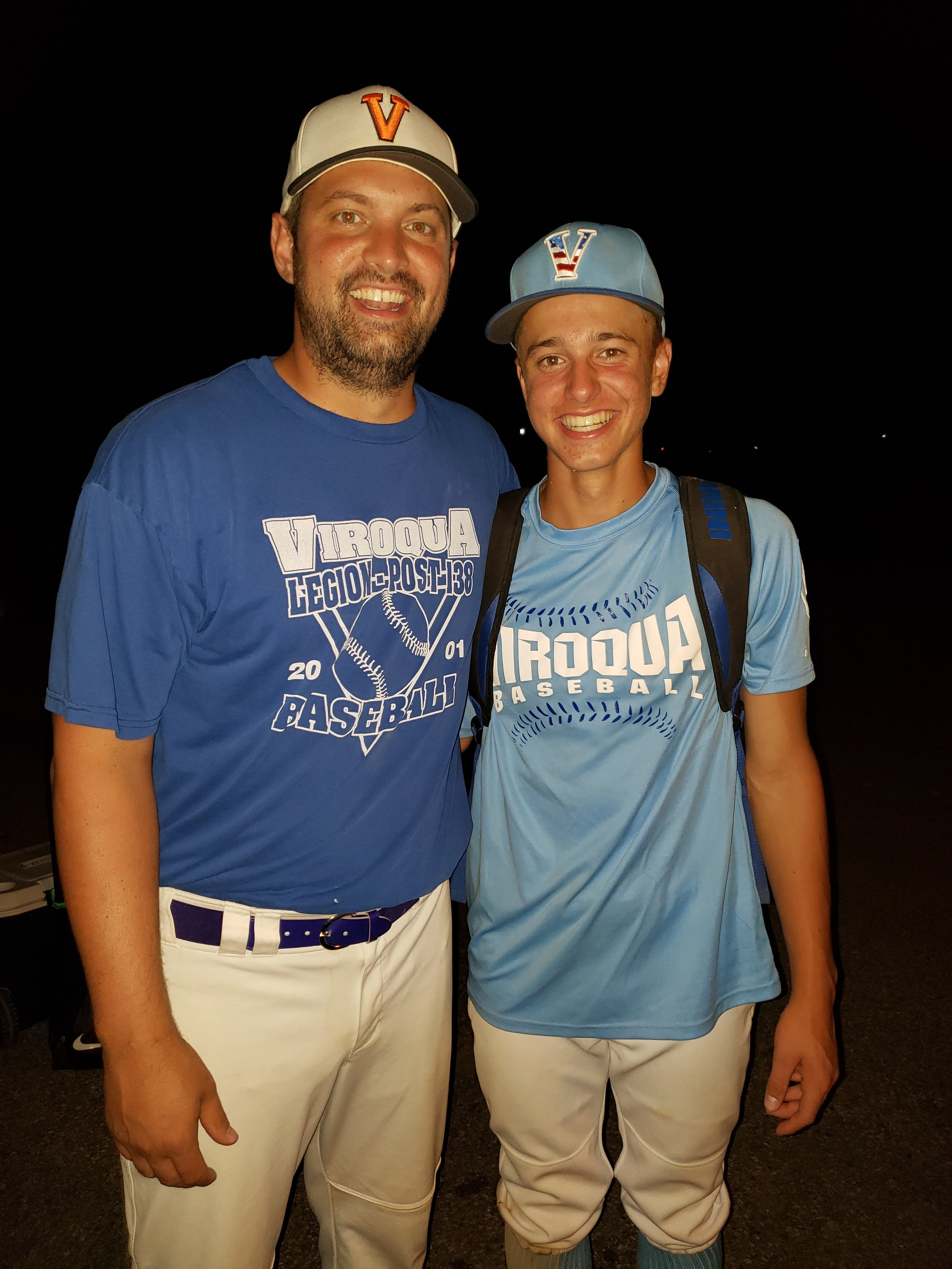 tim and his nephew playing together in an alumni baseball tournament