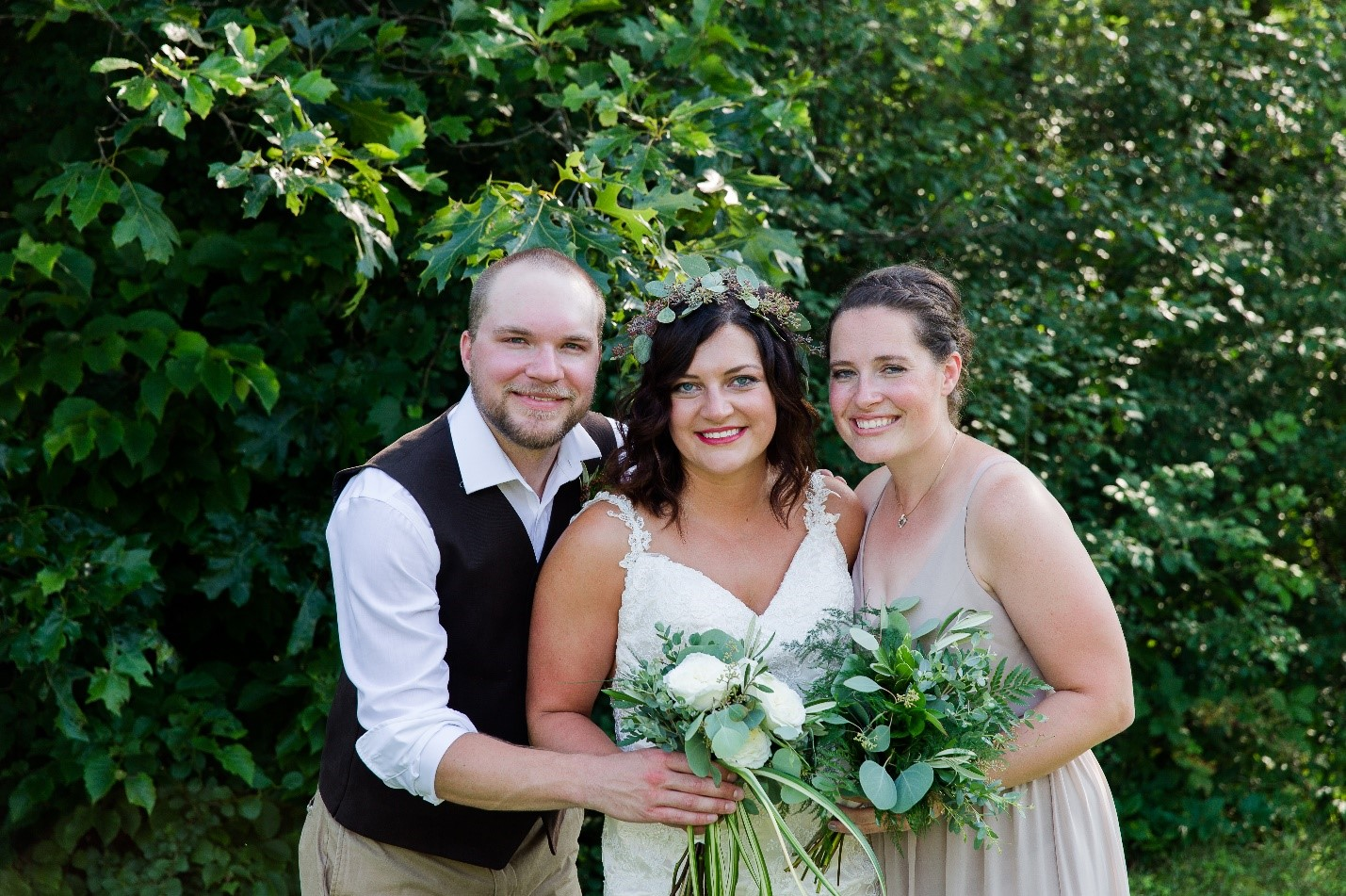Sibling love! Sarah with her brother Craig and sister Kristi on our wedding day