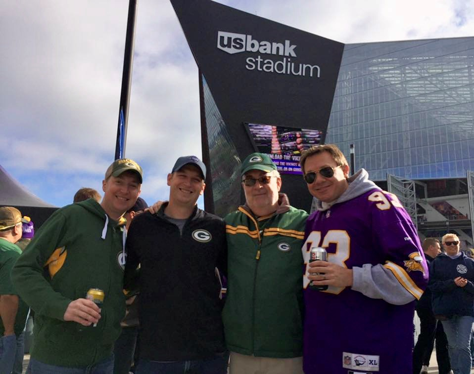 both of our families bring us a lot of joy. here is kevin with his older brother, dad and brother-in-law at a packers versus vikings game.