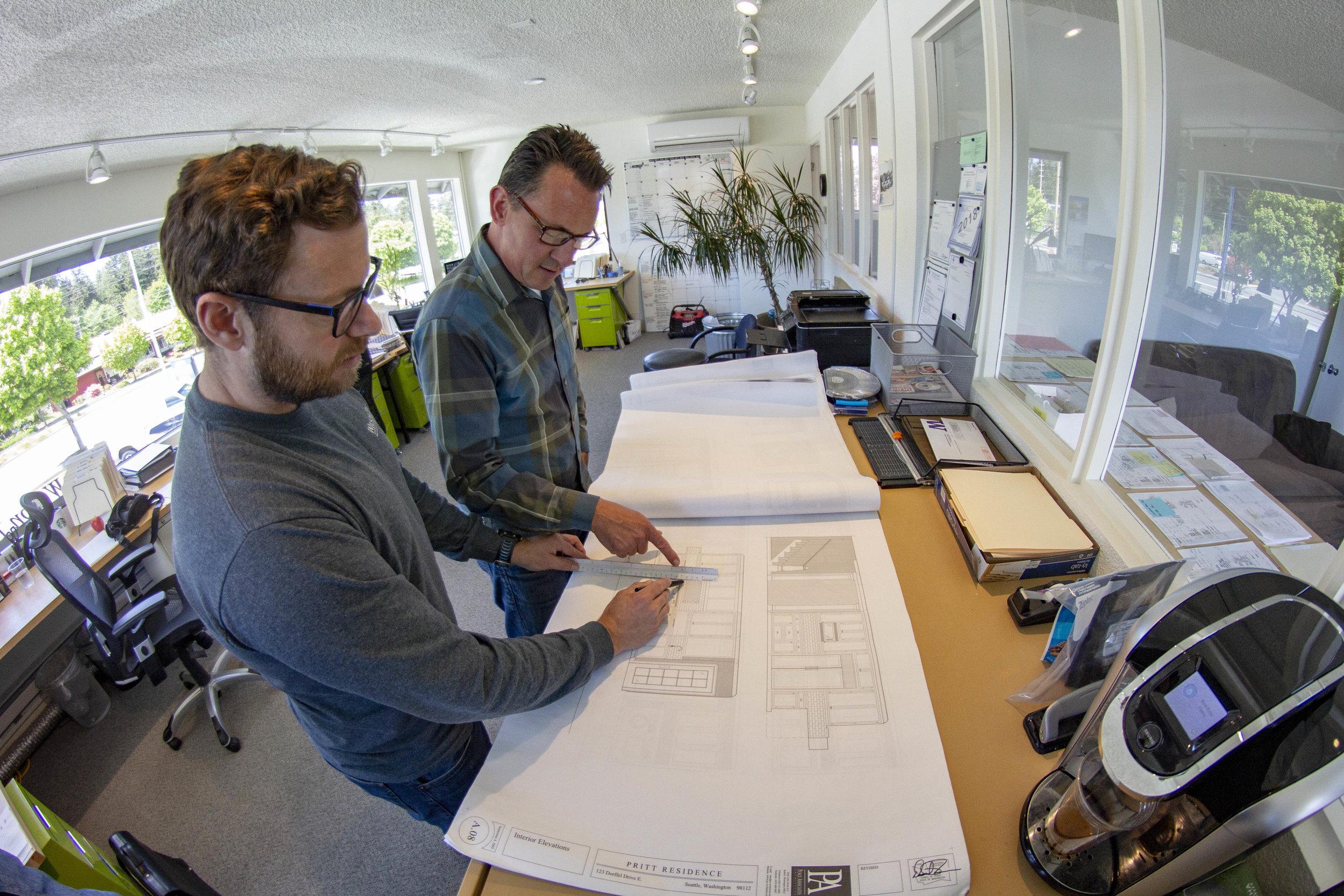 Darren and Sean looking over blueprints in office.jpg