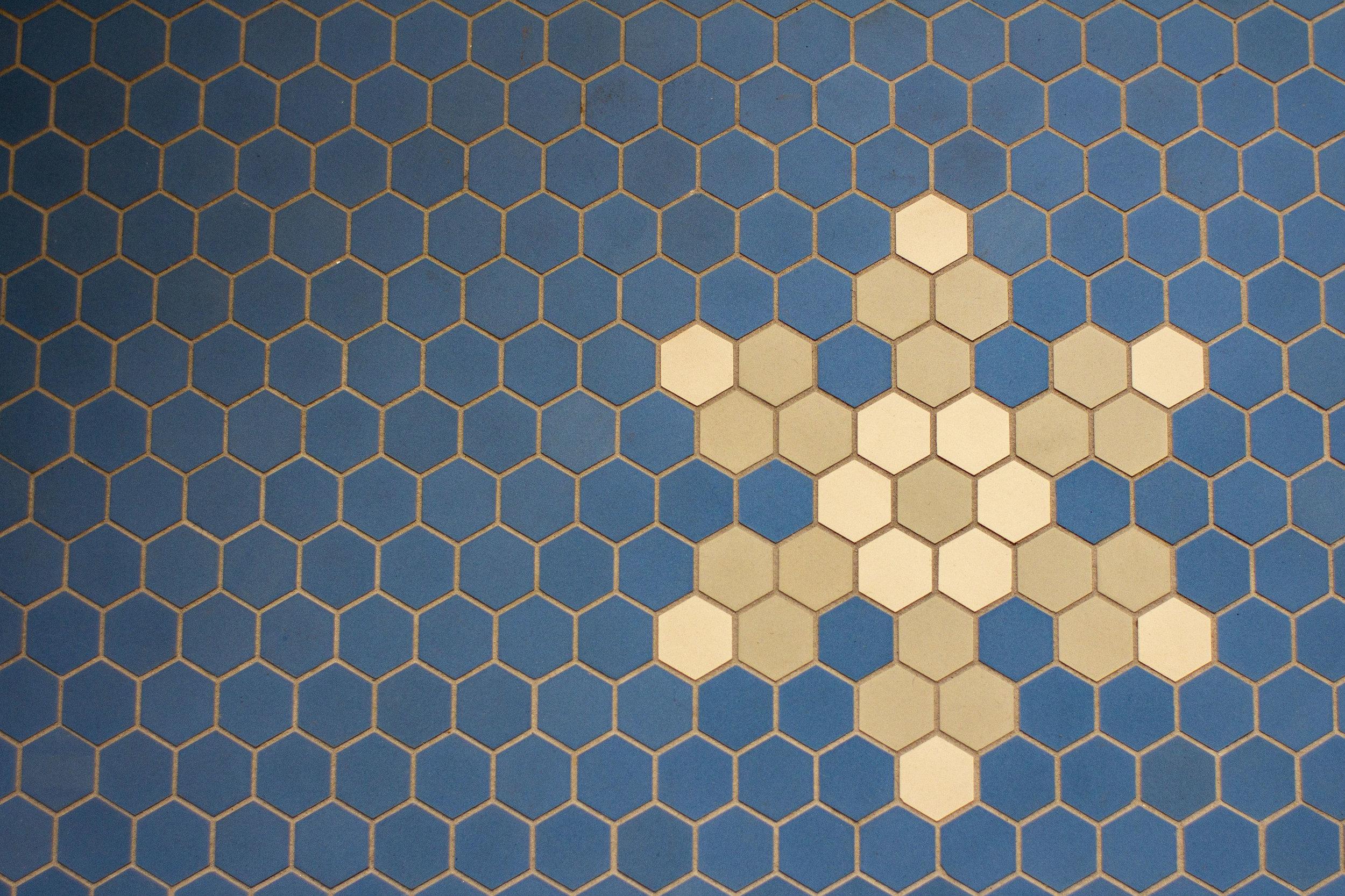 Blue tile with light snowflake design.jpg