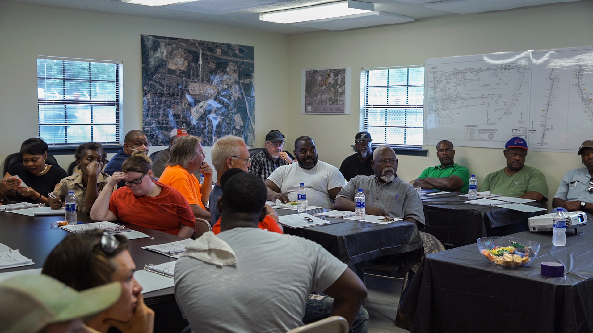 Individuals receive special training at the Site's Community Resource Building as part of the Pine Yard removal action project.