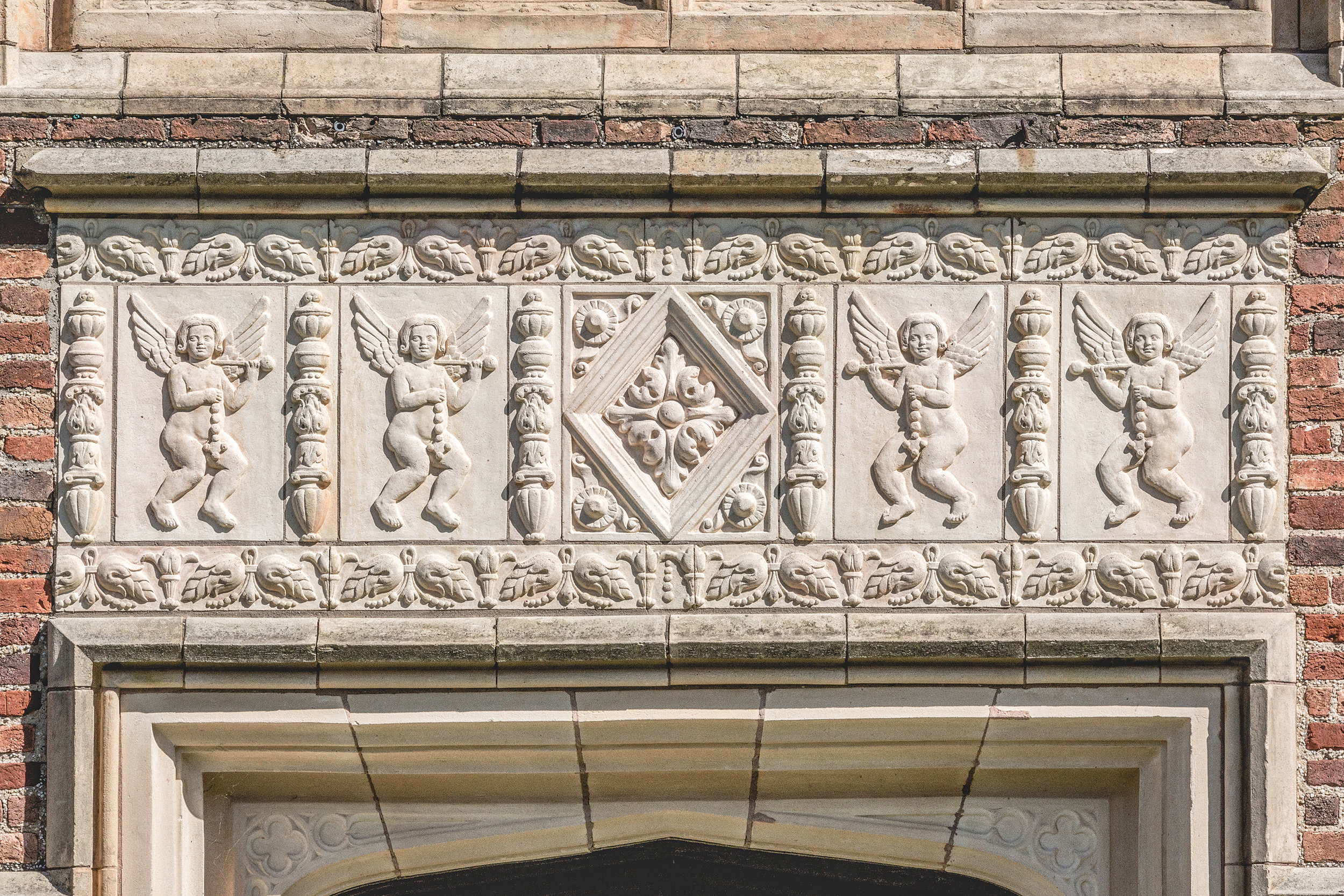 Terracotta carvings of amorini above Guildford's west entrance doors are identical to those at Sutton Place in England.
