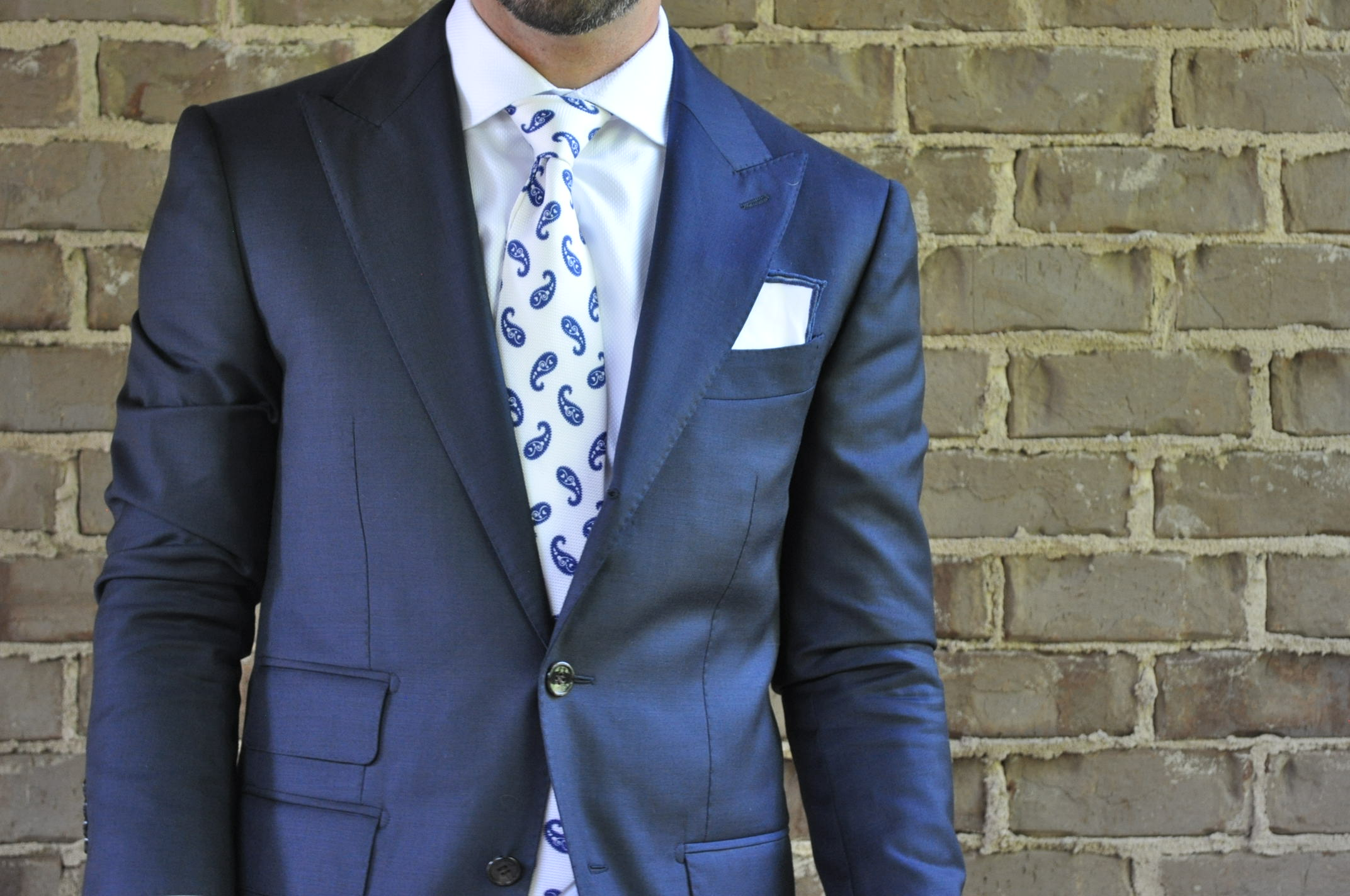 Here again, the pocket square picks up the colors in the outfit. -