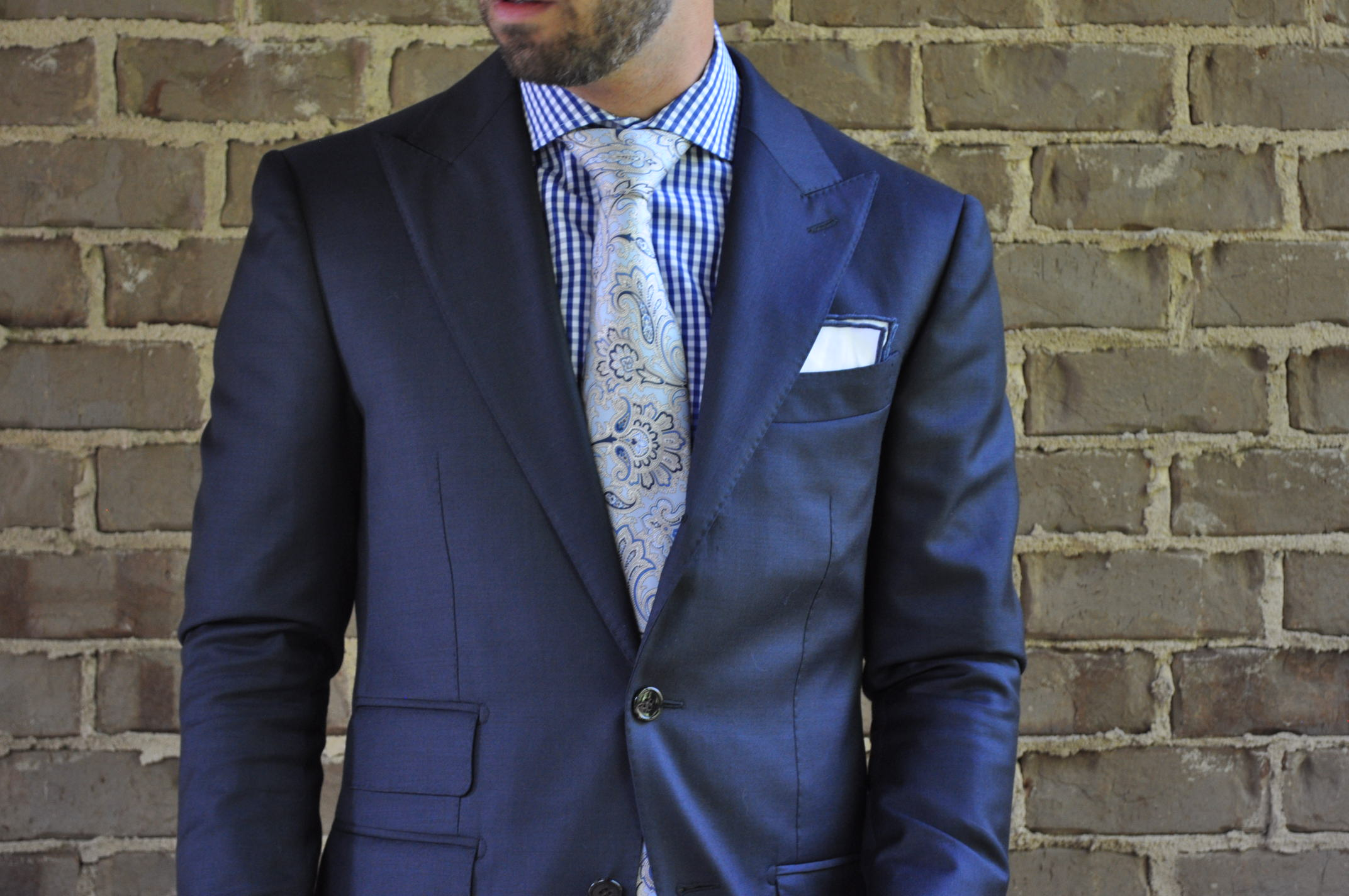 Here the shirt and tie are loud, but the same pocket square works as a simple accent. -