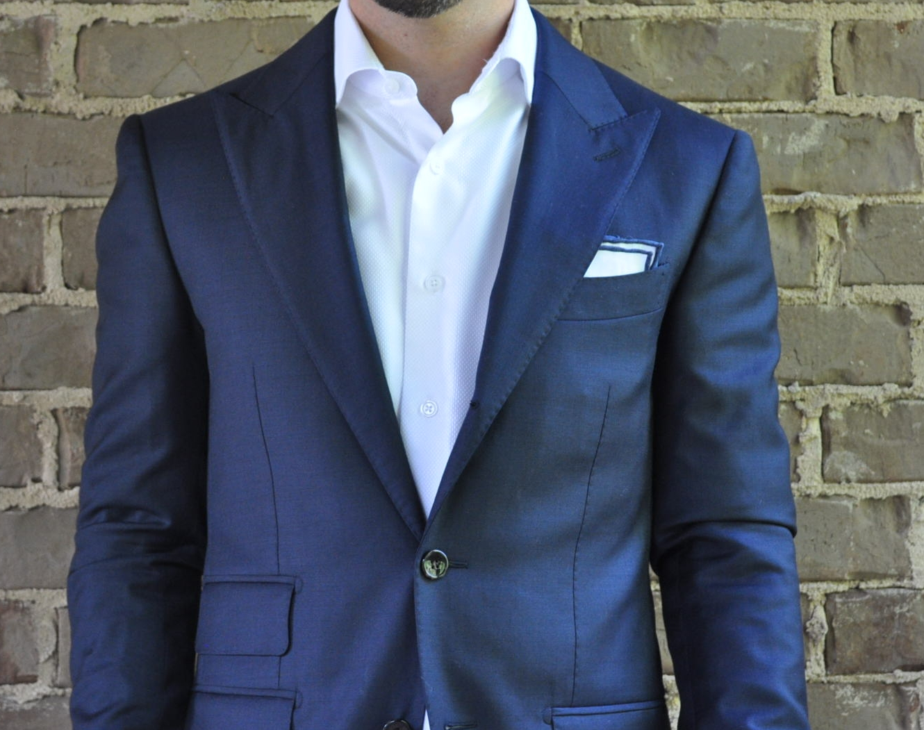 With a simple outfit, adding a simple pocket square will really set your look apart. -