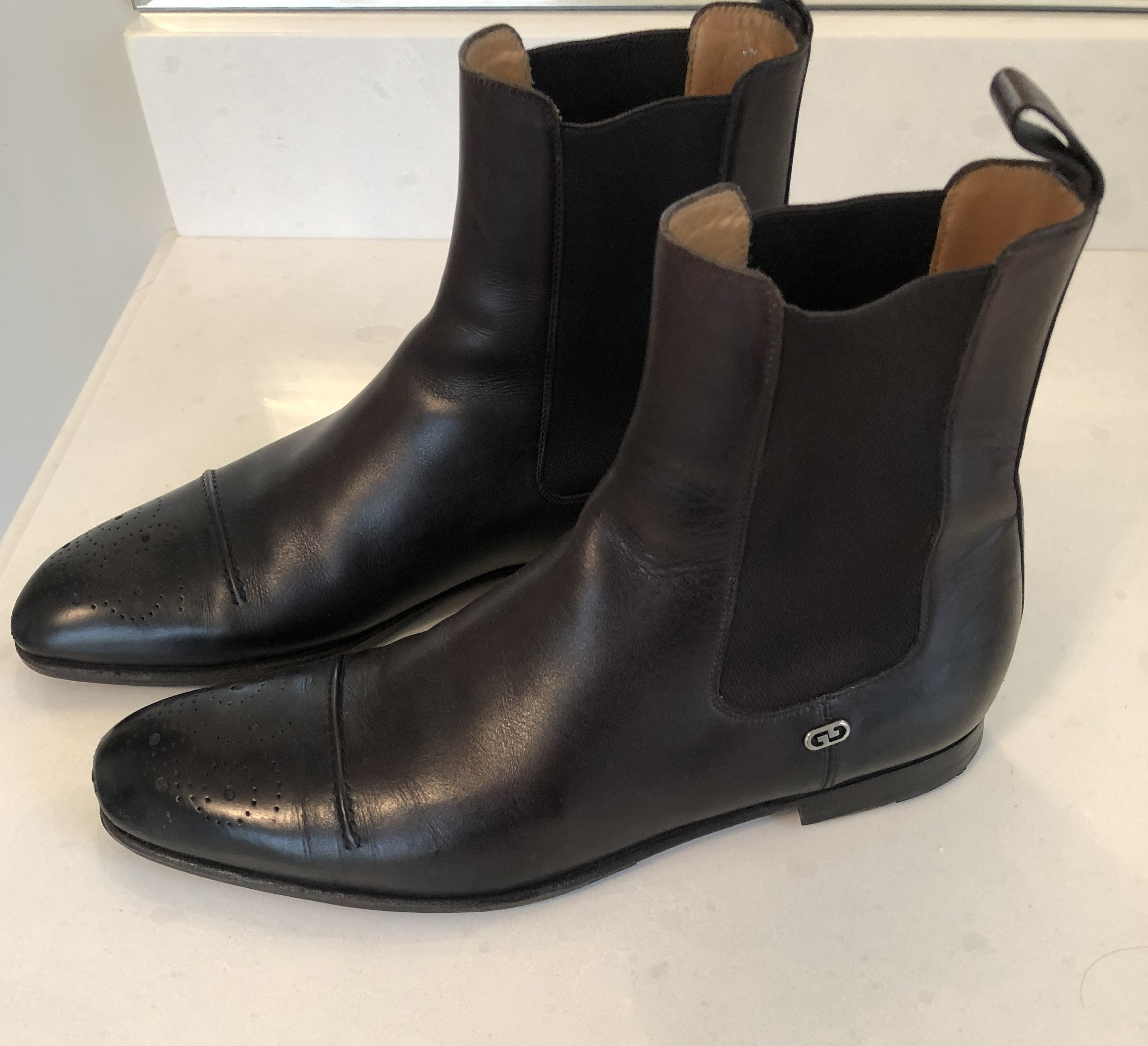 Like these black Chelsey boots by Gucci.