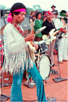 "HENRY DILTZ    Jimi Hendrix playing ""The Star Spangled Banner,"" Woodstock, NY,  1969 Pigment print 11 x 14 inches Signed Retail framed: $600 © and courtesy Henry Diltz and Morrison Hotel Gallery     Learn More"