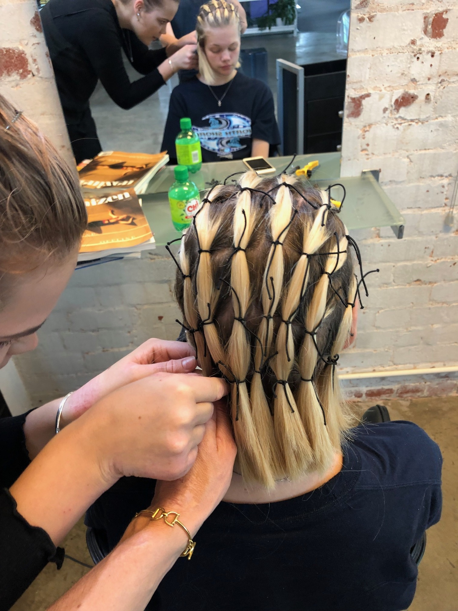 We purposely left Rune with re-growth colour in her hair to give a wonderful multi dimension colour and raw feel to the finished look. Using L'Oreal Professionnel TechniART liss control we created a smooth foundation to begin working from. We then sectioned her hair into 8 vertical sections and systematically worked in squares tying off the hair to mimic cornrows or chain mail. The knots were left visible to give a home made armor look. Because it was a classic Wellington windy day and we were shooting out on locations , we applied TechniART fix max in between the rows to seal the hair and finshed with a dusting of TechniART ring light.