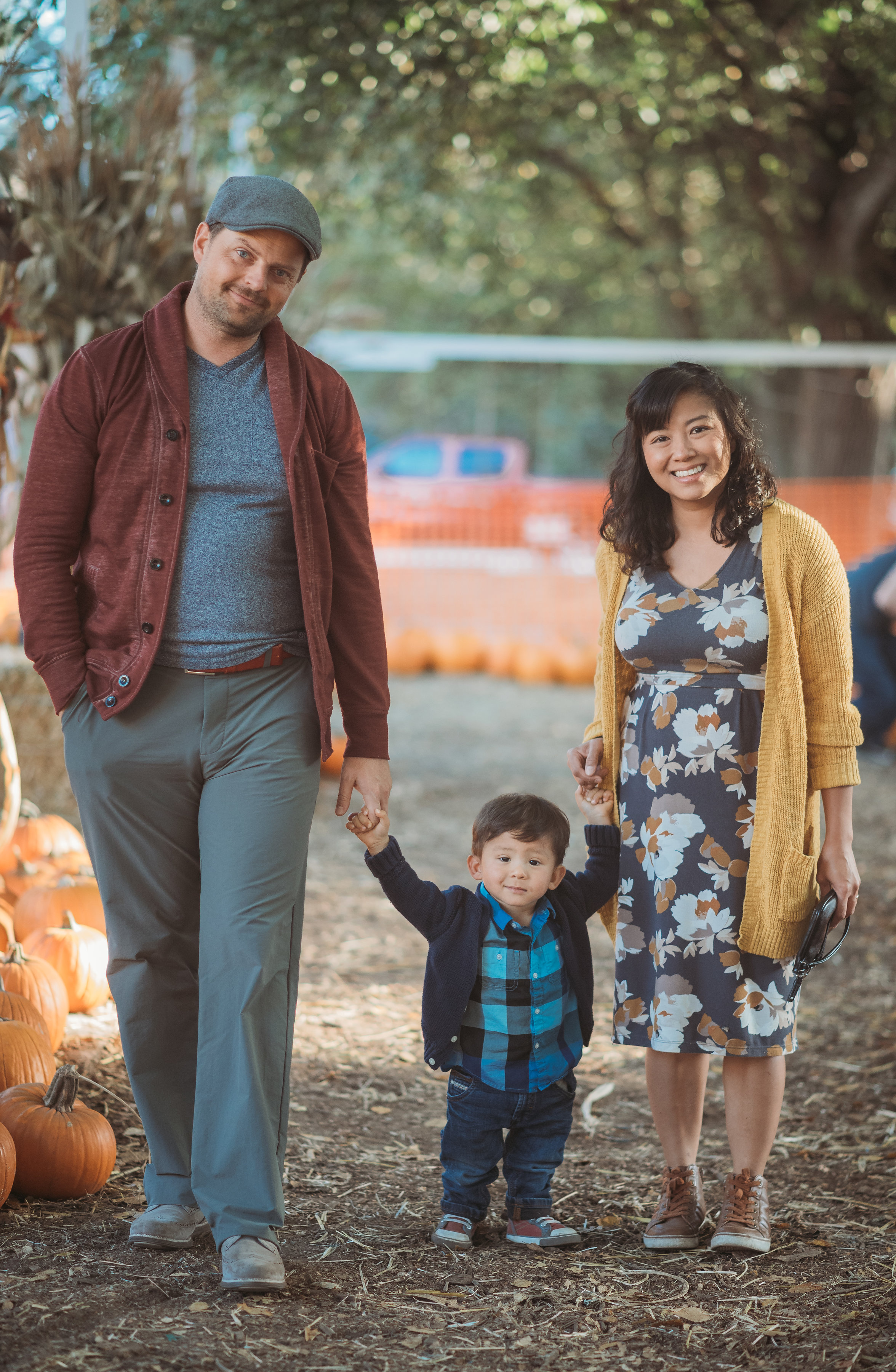 - There are so many directions to go for a fall photo shoot, but I love incorporating the beautiful colors that fall and fall festivals provide! Here, the family keeps the subtle blue/grey element and gives a fall vibe by adding a rust-colored sweater for Dad and a mustard cardigan for Mom. And darling Son's outfit adds dimension with the plaid and jacket!