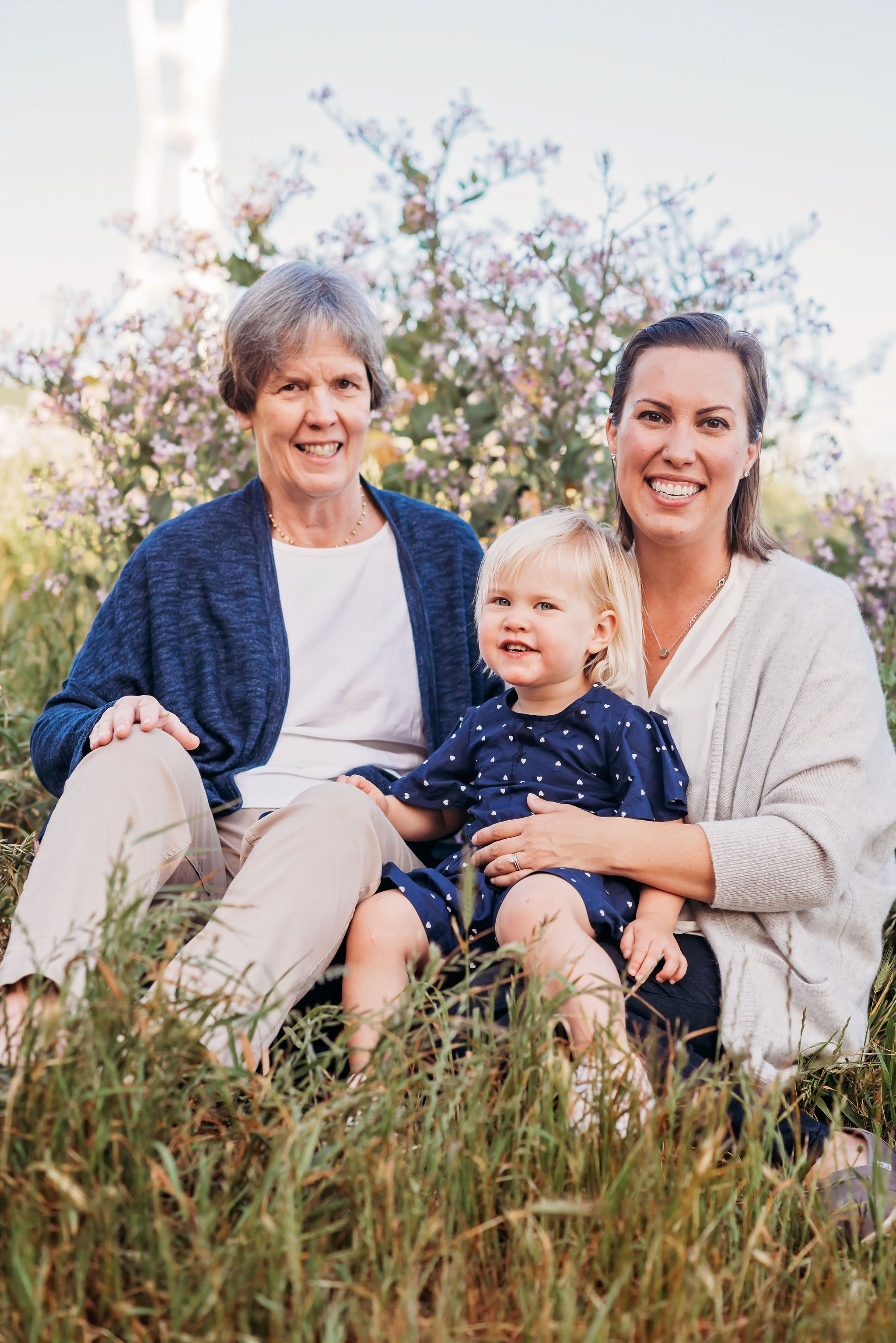 I love this three-generation photo! The two colors in their palette were navy and cream; this was balanced out by having Grandma in a navy cardigan, Mom in a cream shirt + sweater, and sweet Daughter in her navy polk-a-dots. Another example of why you only need one patterned piece in a photo!