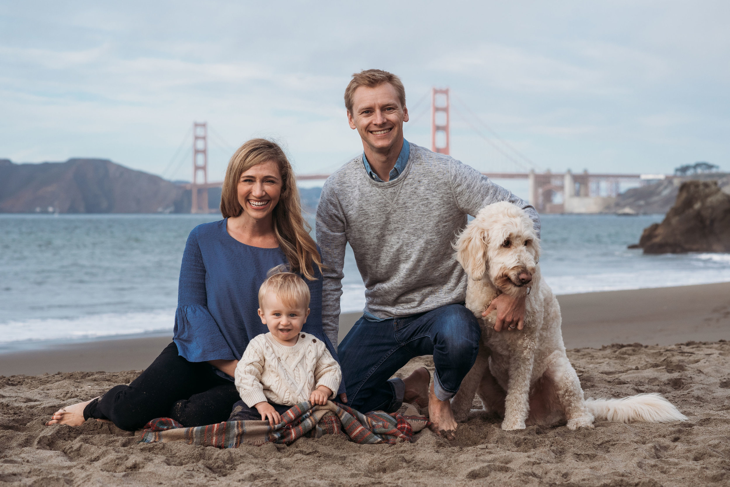 I love not only incorporating the four-legged family member, but also keeping the style here timeless! With their color palette and outfit choices, this is an image that won't go out of style.