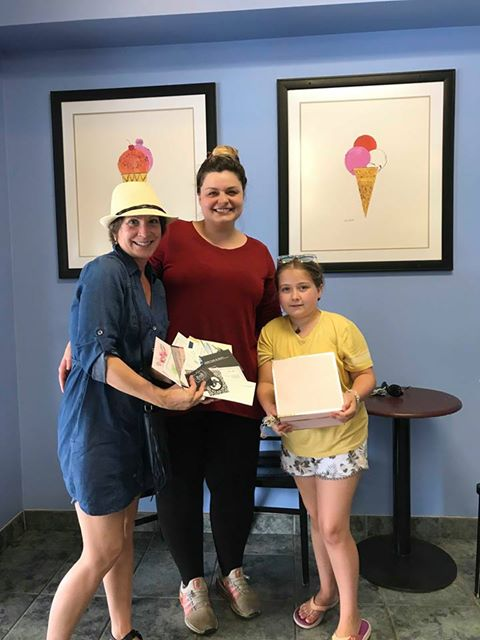 Left to right: Anna Radey, special events committee chair, shopping spree winner, Tracey Evans, and her daughter, Olivia.