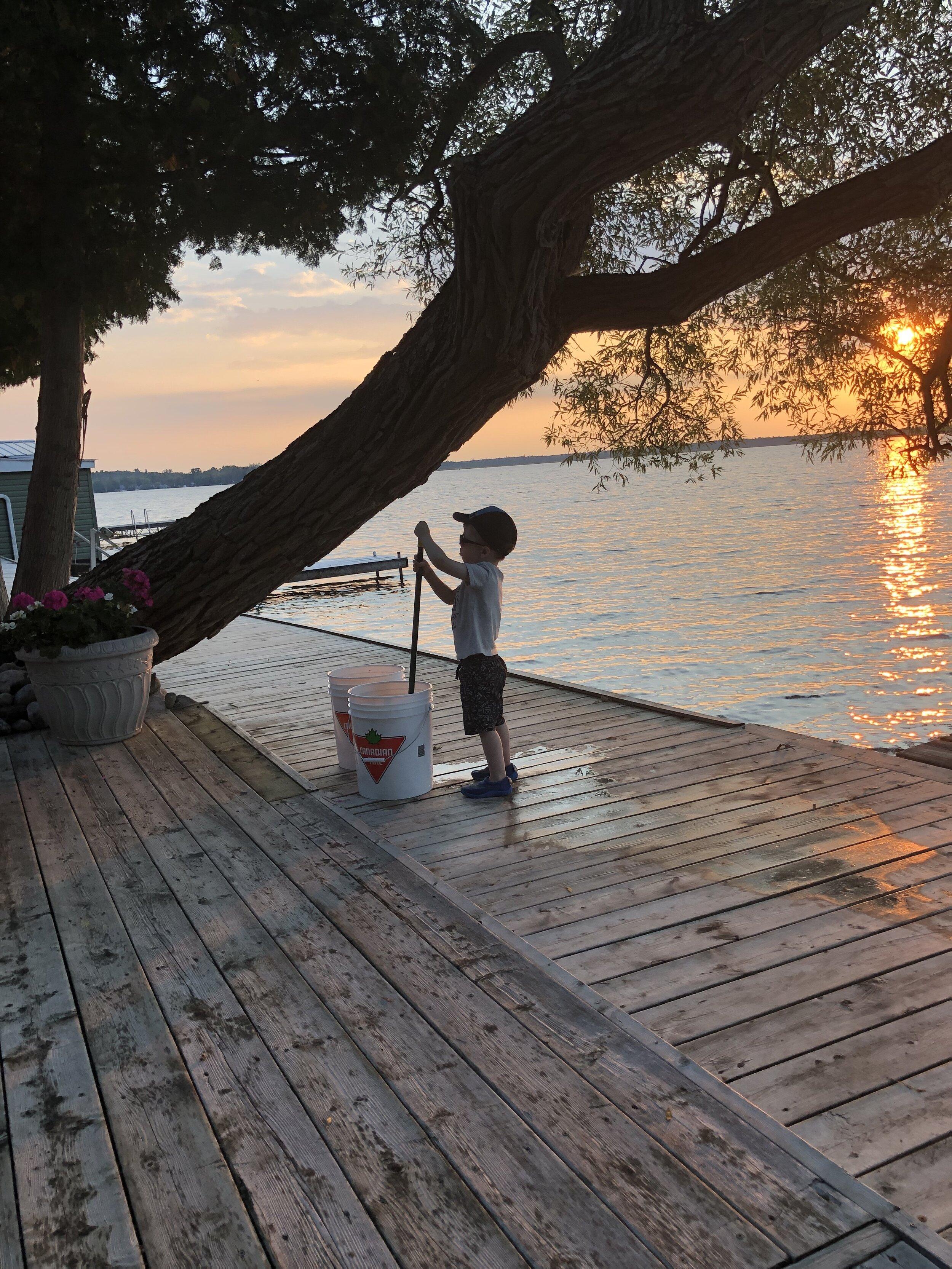"""""""Grandson washing the cottage deck"""" - Garry Watson"""