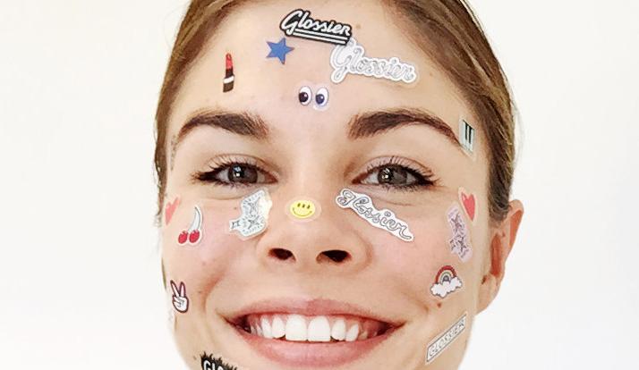 Emily Weiss having some sticker fun.