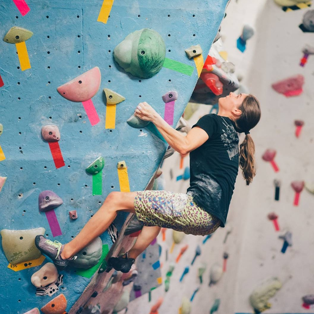 Amanda Maze testing a problem set by another route setter at  First Avenue Rocks . Photo by  Joel Valencia .