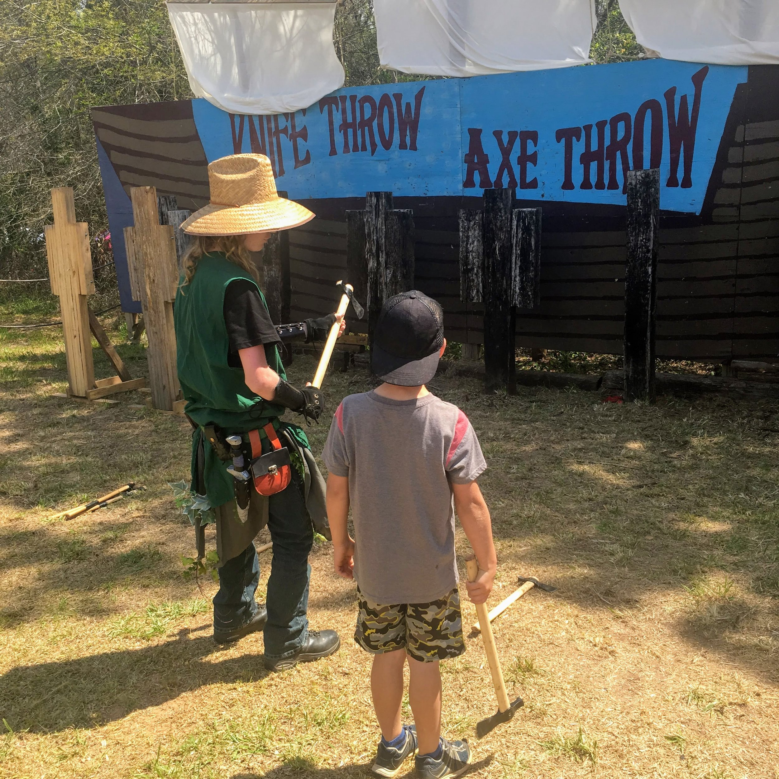 Knife and axe throwing at the Alabama Medieval Fantasy Festival. Photo by Sharron Swain