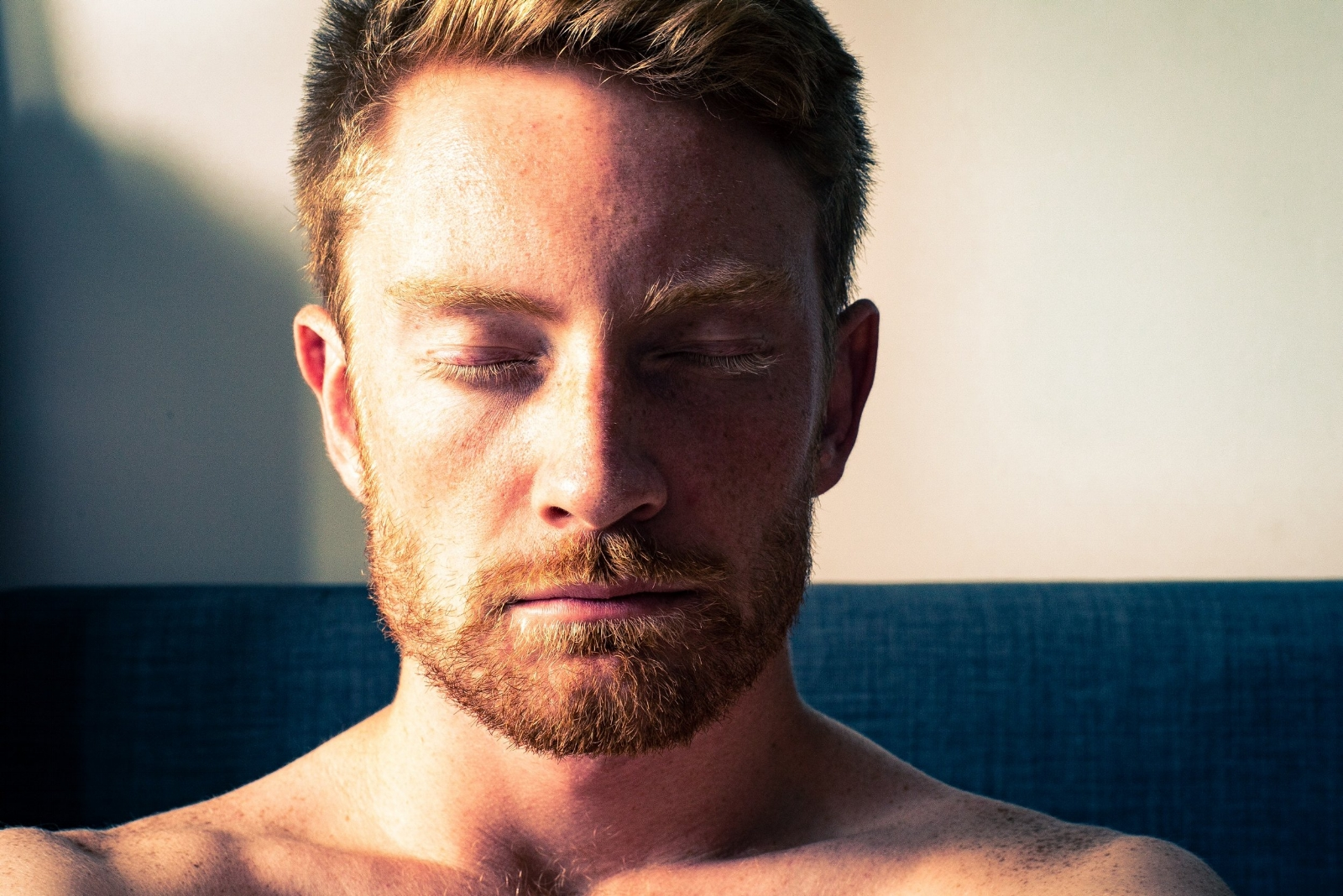 Man meditating with closed eyes_phot by mitchell griest.jpg