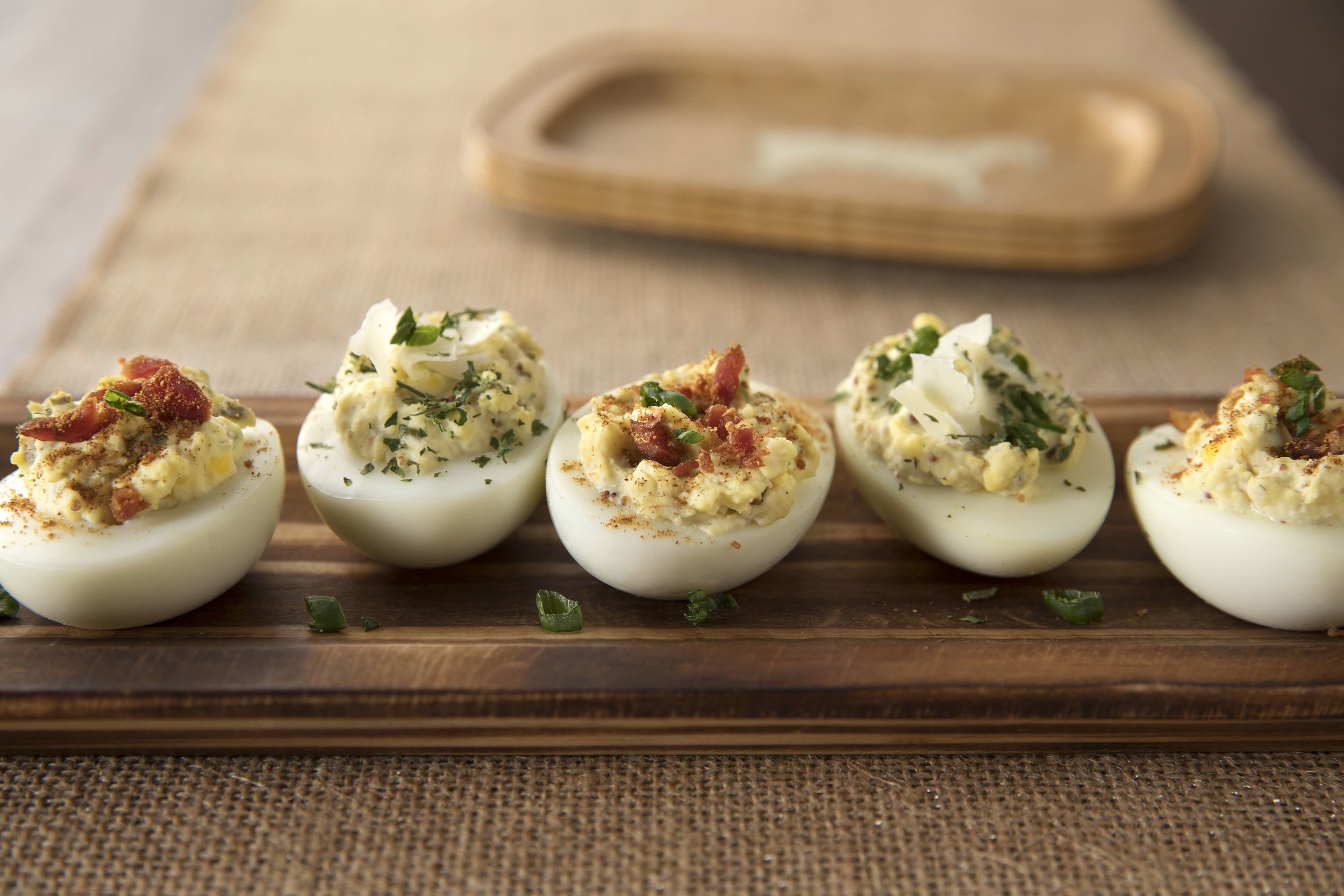 Classic Deviled Eggs - Ingredients6 peeled hardboiled eggs2 tubs darling white cheddar & mustard pickle dipoptional: bacon bits, green onions, parsley for garnishInstructions slice eggs length wise and scoop out yolks. Mash yolks with 2 tubs of darling pickle dips and spoon back into eggs. Garnish with bacon bits, fresh parsley or green onions and serve.