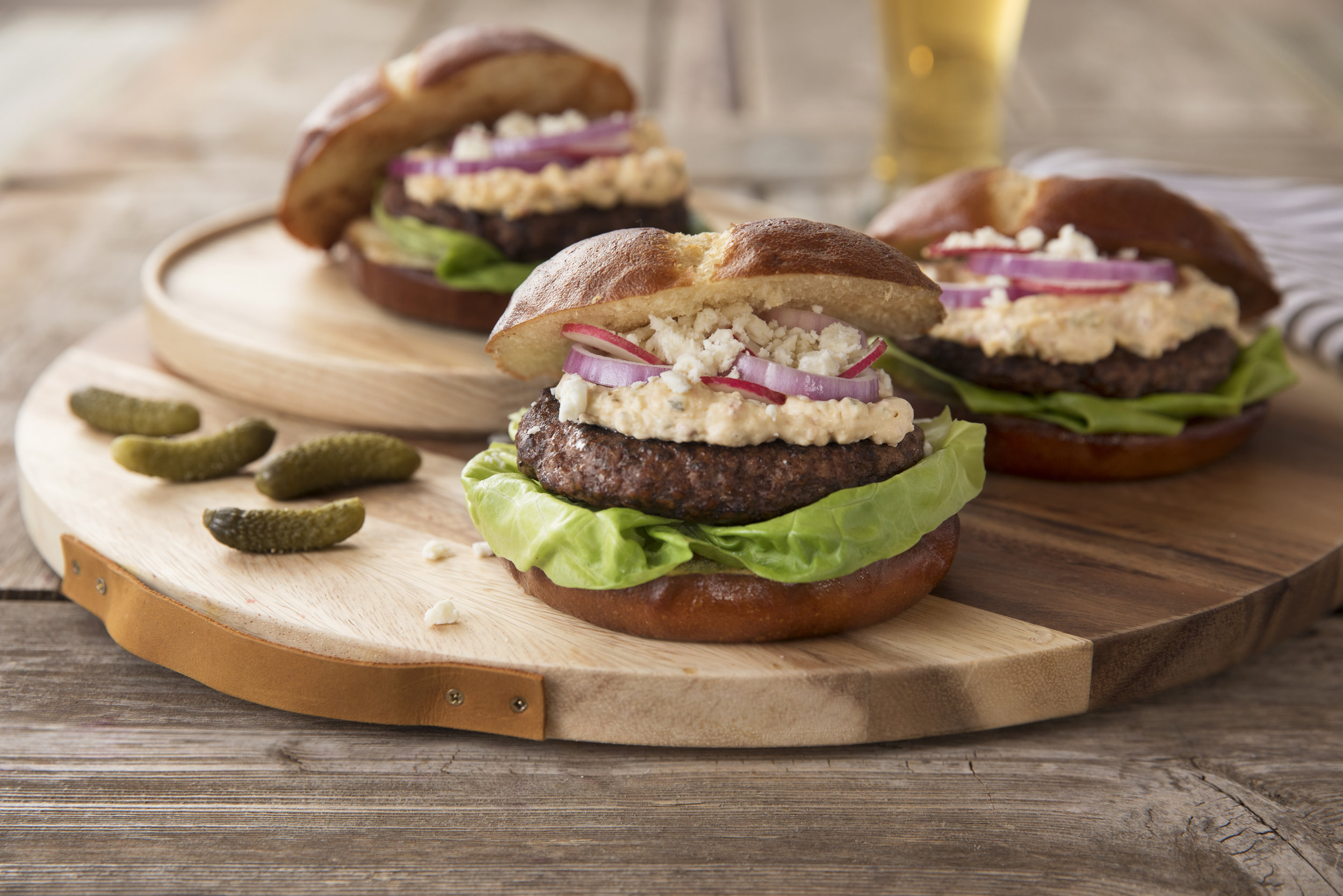 Spicy Pickle Burger - Ingredients 4 seasoned burger patties1 tub darling spicy pickle dipoptional: buns, sliced tomatoes,onions and lettuceInstructionsAfter grilling your burgers, smear patty with spicy pickle dip and top with the burger accompaniments of your choice.