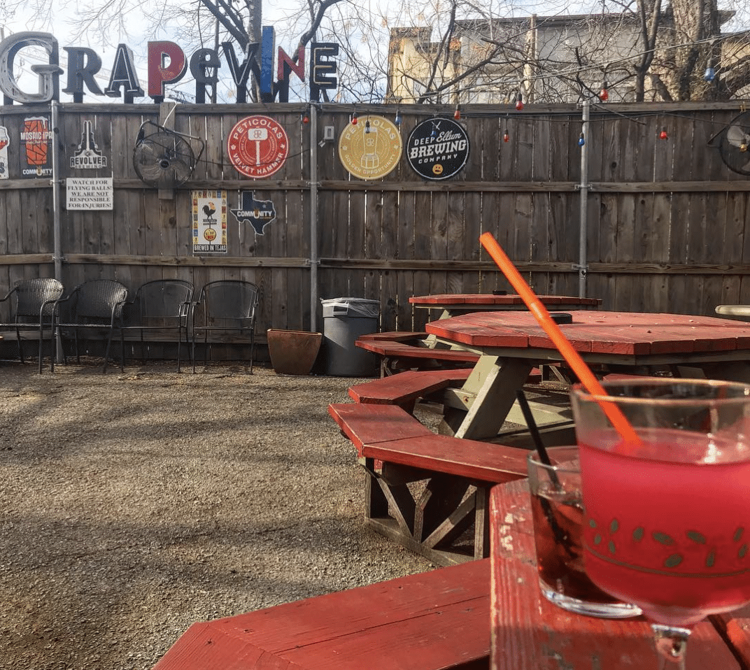The Grapevine Bar - A hazy night at The Grapevine should be on a Dallas Bar Fly bucket list. But if you'd rather venture out to their huge back patio for cocktails, meeting a large group of friends at one of the giant picnic tables, or shooting hoops, that's okay too. (3902 Maple Avenue)